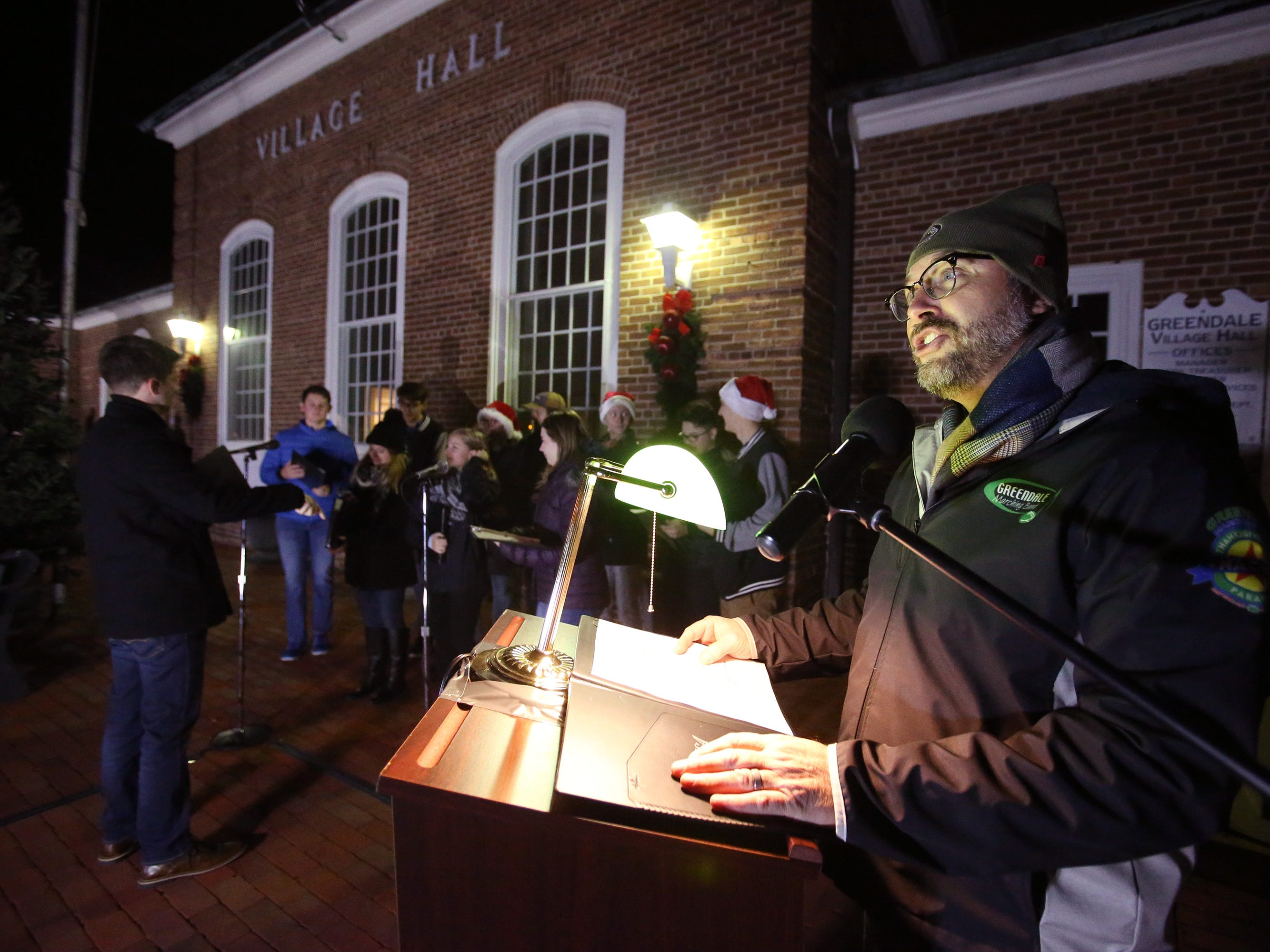 Dr. Gary Kiltz, superintendent of the Greendale school district, greets the crowd waiting for thousands of lights to illuminate and for Santa to arrive as part of Greendale's annual Tree Lighting in front of Village Hall on Nov. 23.