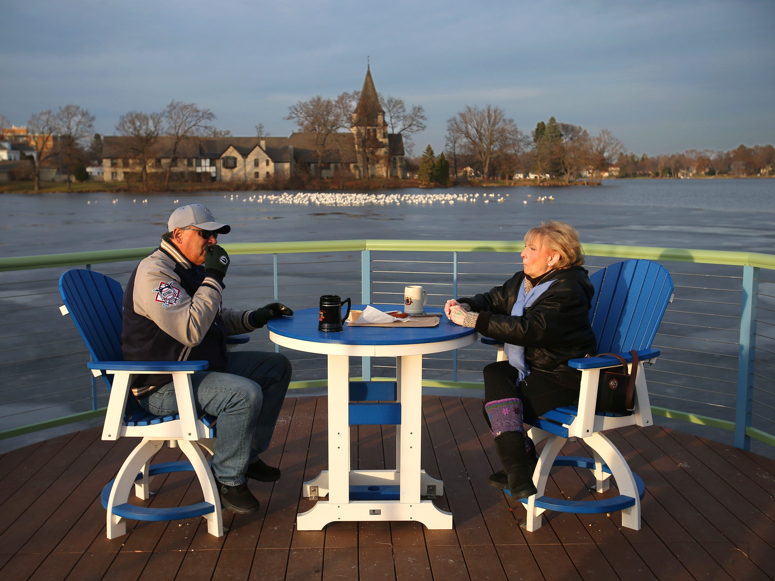 Wayne and Deborah Pepper find a quiet spot for a snack during the German Christmas Market of Oconomowoc on Nov. 23.