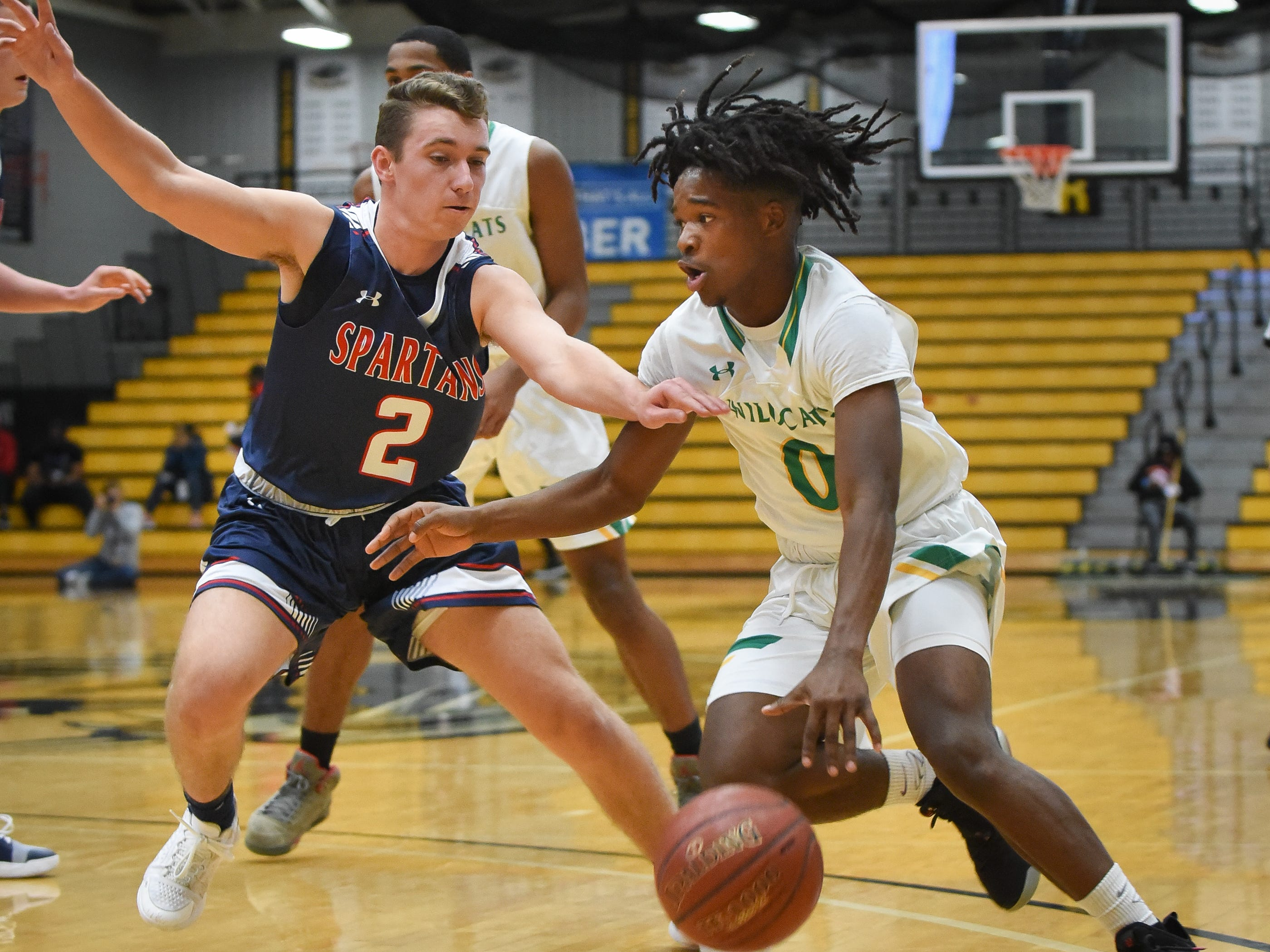 Milwaukee Hamilton junior guard Terrion Oliver drives against Brookfield East junior guard MIchael Poker in the Fresh Coast Classic high school basketball showcase Saturday, November 24, 2018, at UW-Milwaukee's Klotsche Center.