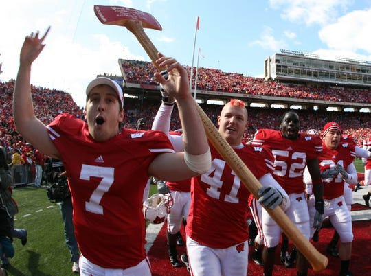 Wisconsin's Mark Zalewski carries the Paul Bunyan Axe around the field in 2006.