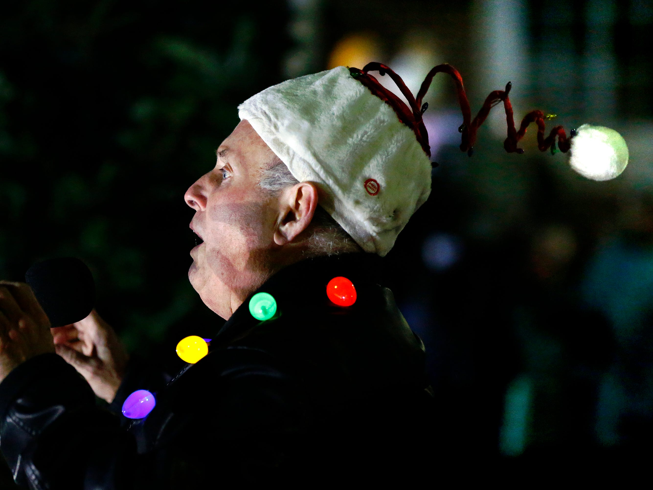 Village President Jim Birmingham begins a countdown with the crowd waiting for thousands of lights to illuminate and for Santa to arrive as part of Greendale's annual Tree Lighting in front of Village Hall on Nov. 23.