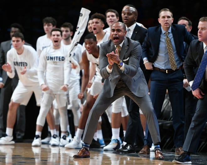 Marquette assistant Stan Johnson was named head coach at Loyola Marymount.