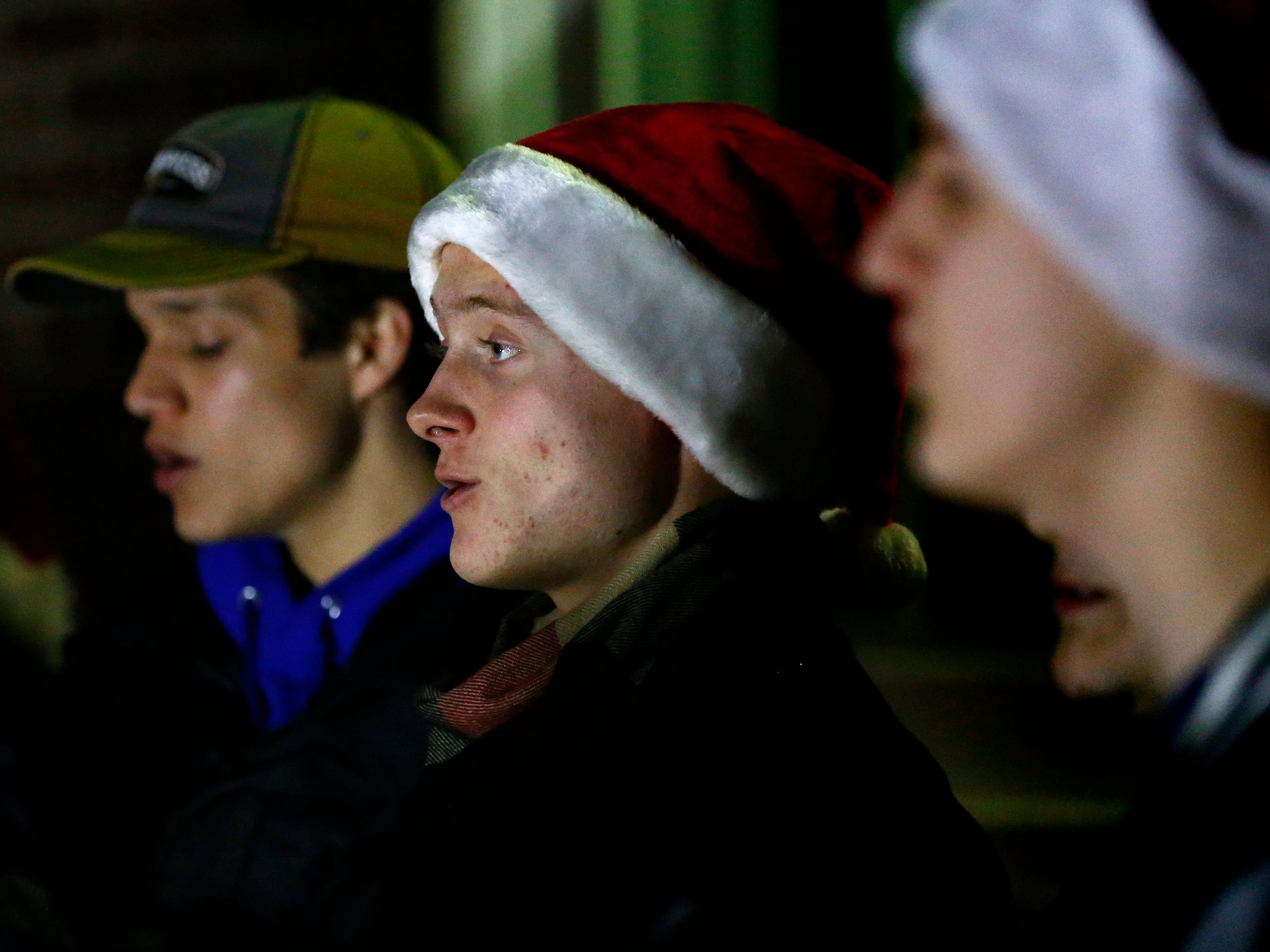The Greendale High School Choir sings seasonal songs for the crowd waiting for thousands of lights to illuminate and for Santa to arrive as part of Greendale's annual Tree Lighting in front of Village Hall on Nov. 23.