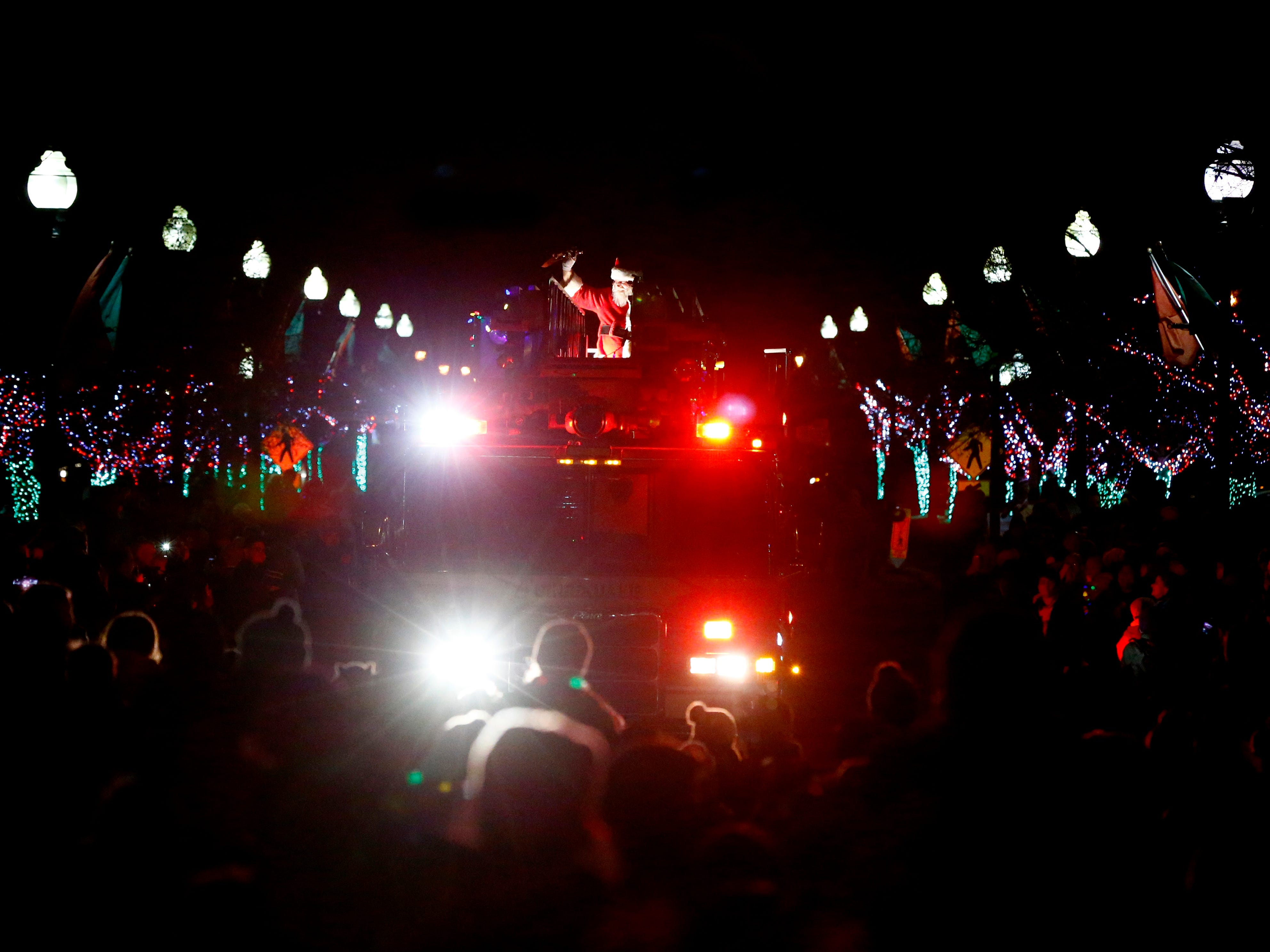 A special guest arrives atop a fire truck after thousands of lights illuminated as part of Greendale's annual Tree Lighting in front of Village Hall on Nov. 23.