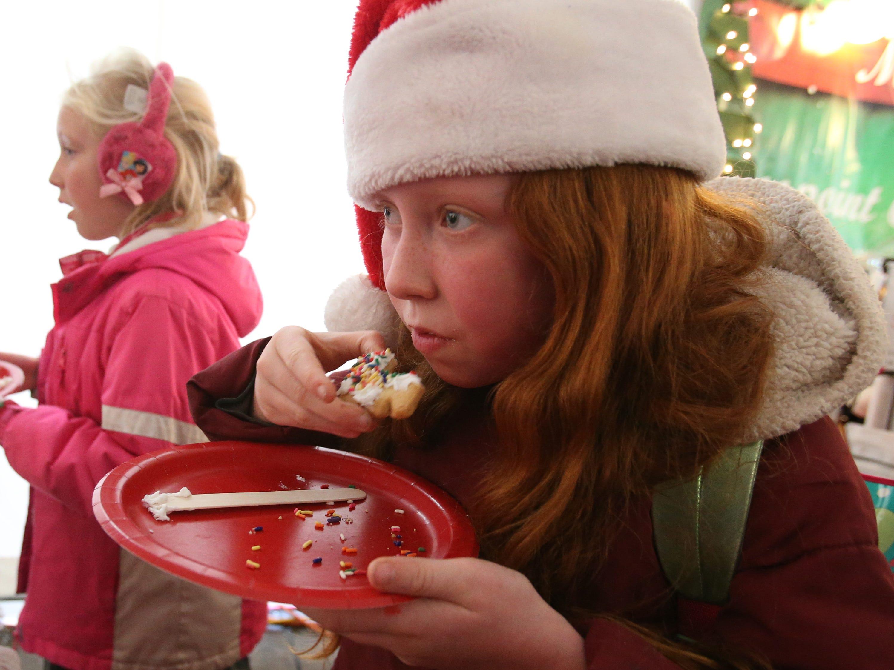 Kalleigh Kuzenski snacks on a cookie she just created at the German Christmas Market of Oconomowoc on Nov. 23.