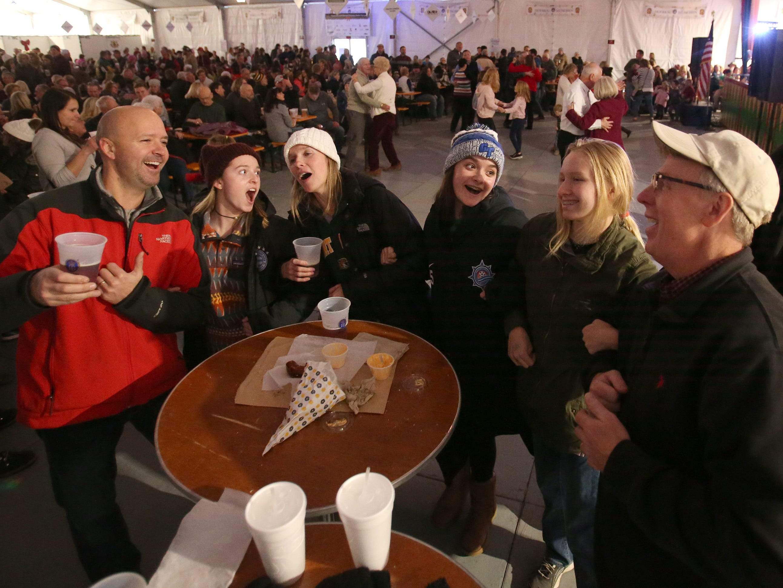 Guests sing and sway to the Freistadt Alte Kameraden Band in the Indoor Bier Garten at the German Christmas Market of Oconomowoc on Nov. 23.