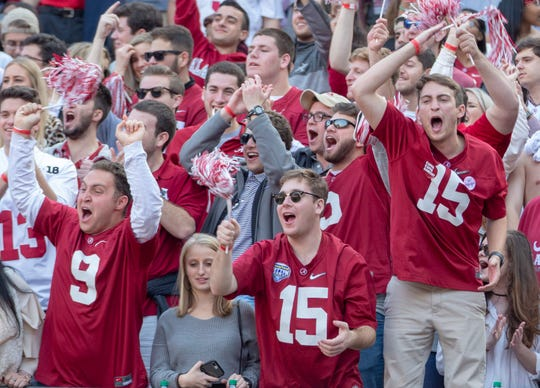 Alabama fans cheer on the Crimson Tide before kickoff.