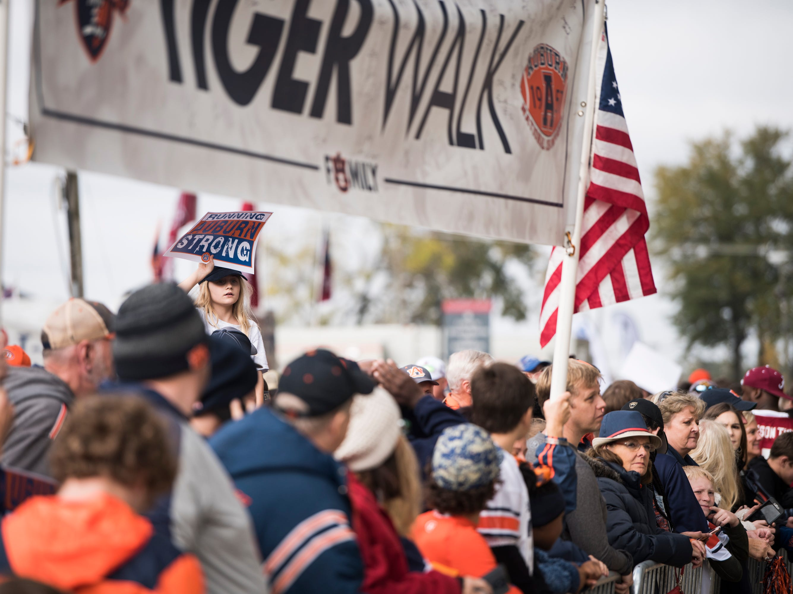 Auburn fans await the teams arrival at Bryant-Denny Stadium in Tuscaloosa, Ala., on Saturday, Nov. 24, 2018.