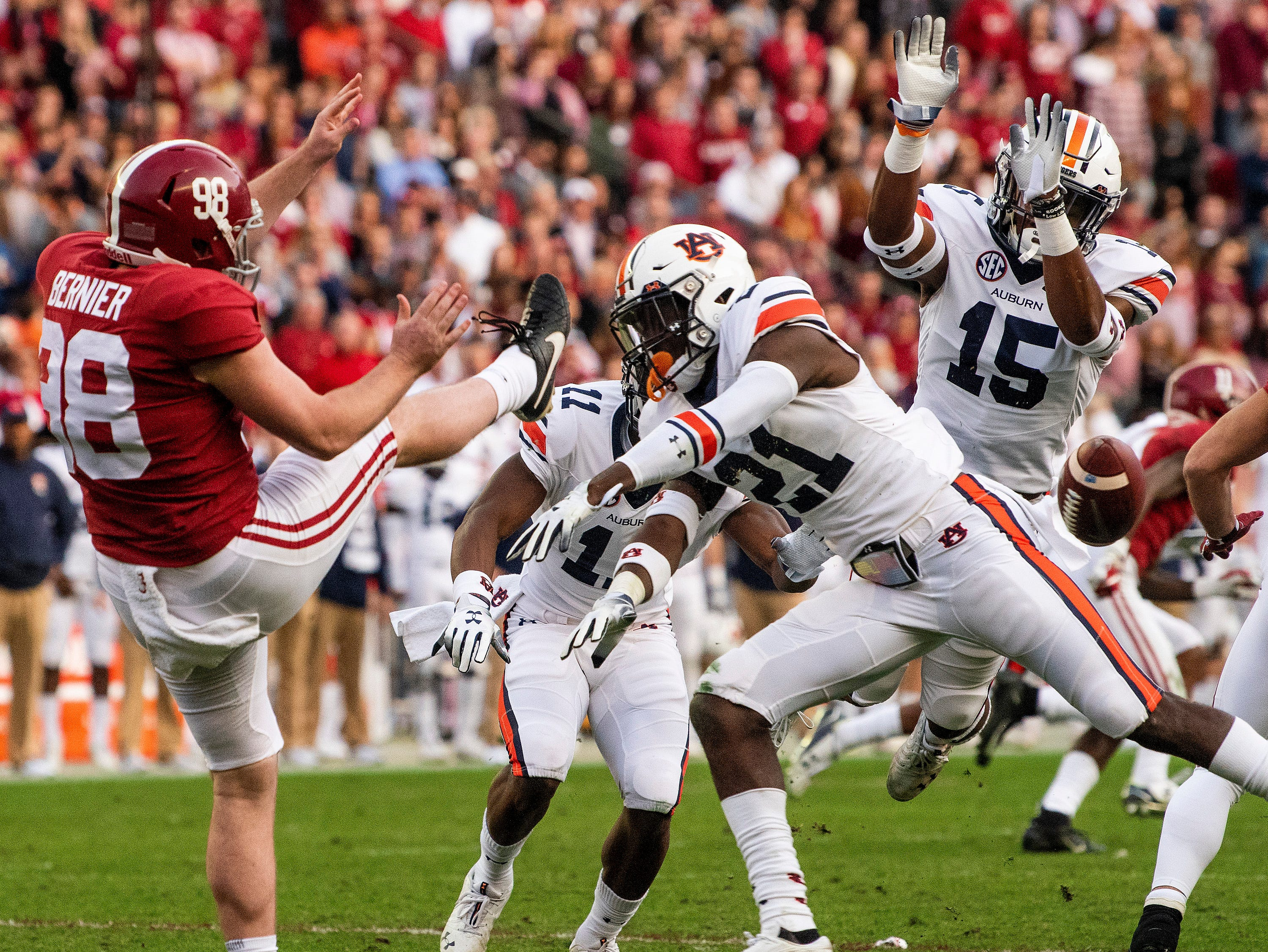 Auburn defensive back Smoke Monday (21) blocks a punt by Alabama punter Mike Bernier (98) in first half action during the Iron Bowl at Bryant-Denny Stadium in Tuscaloosa, Ala., on Saturday November 24, 2018.