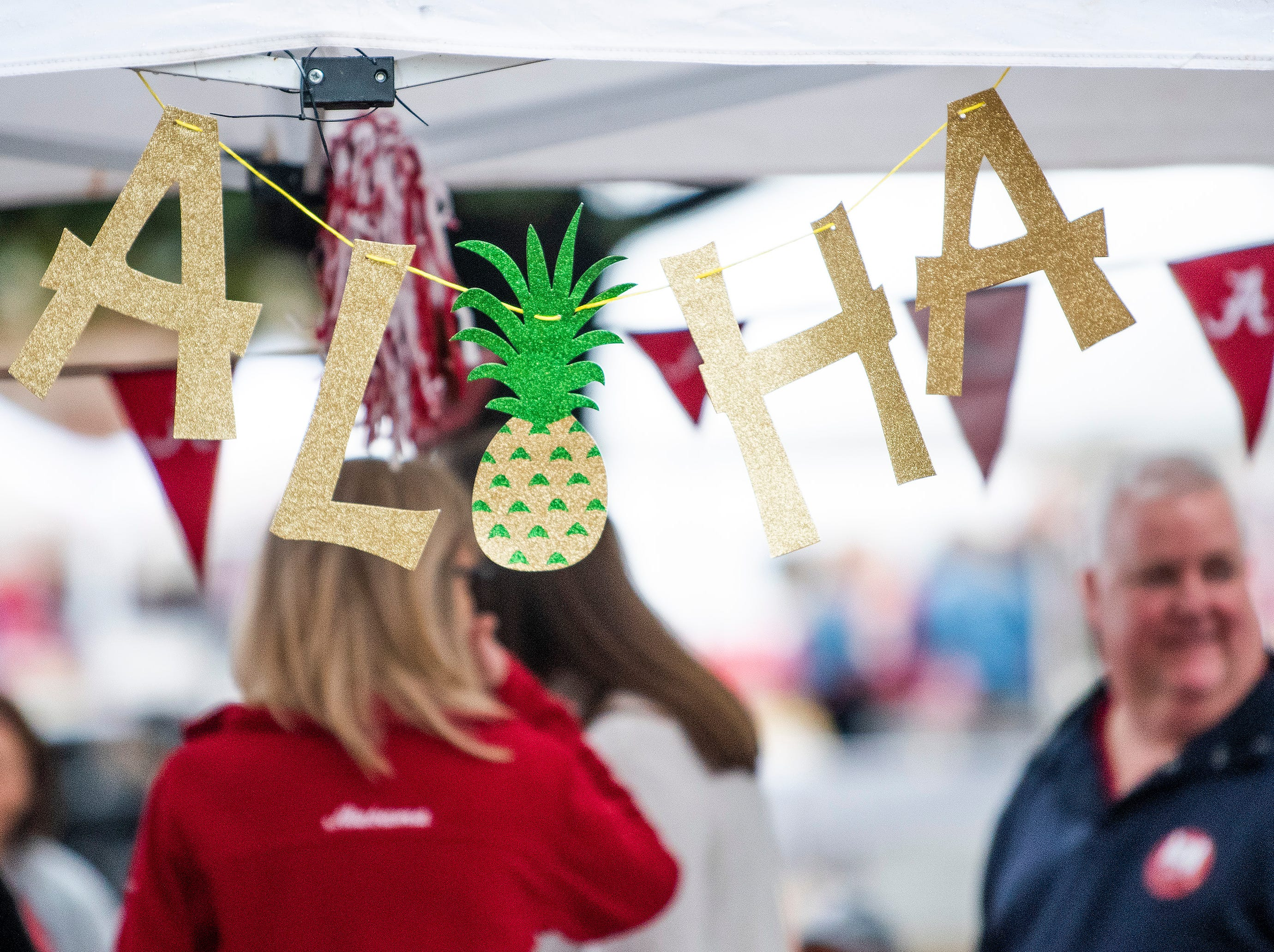 An Aloha sign at an Alabama tailgate before the Iron Bowl at  Bryant-Denny Stadium in Tuscaloosa, Ala., on Saturday November 24, 2018.