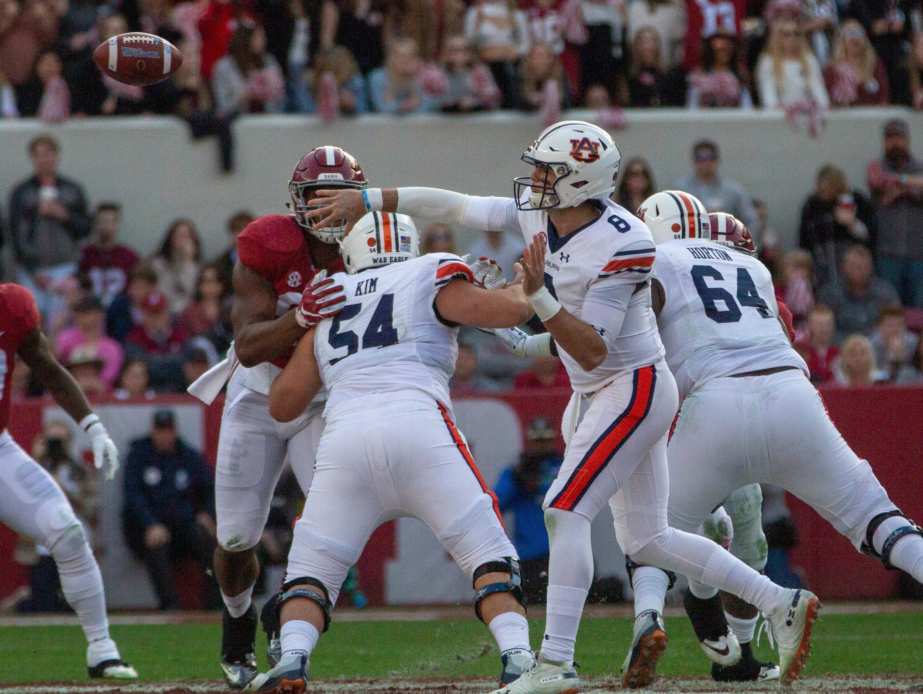Auburn's Jarrett Stidham throws the ball during the first quarter of the Iron Bowl.