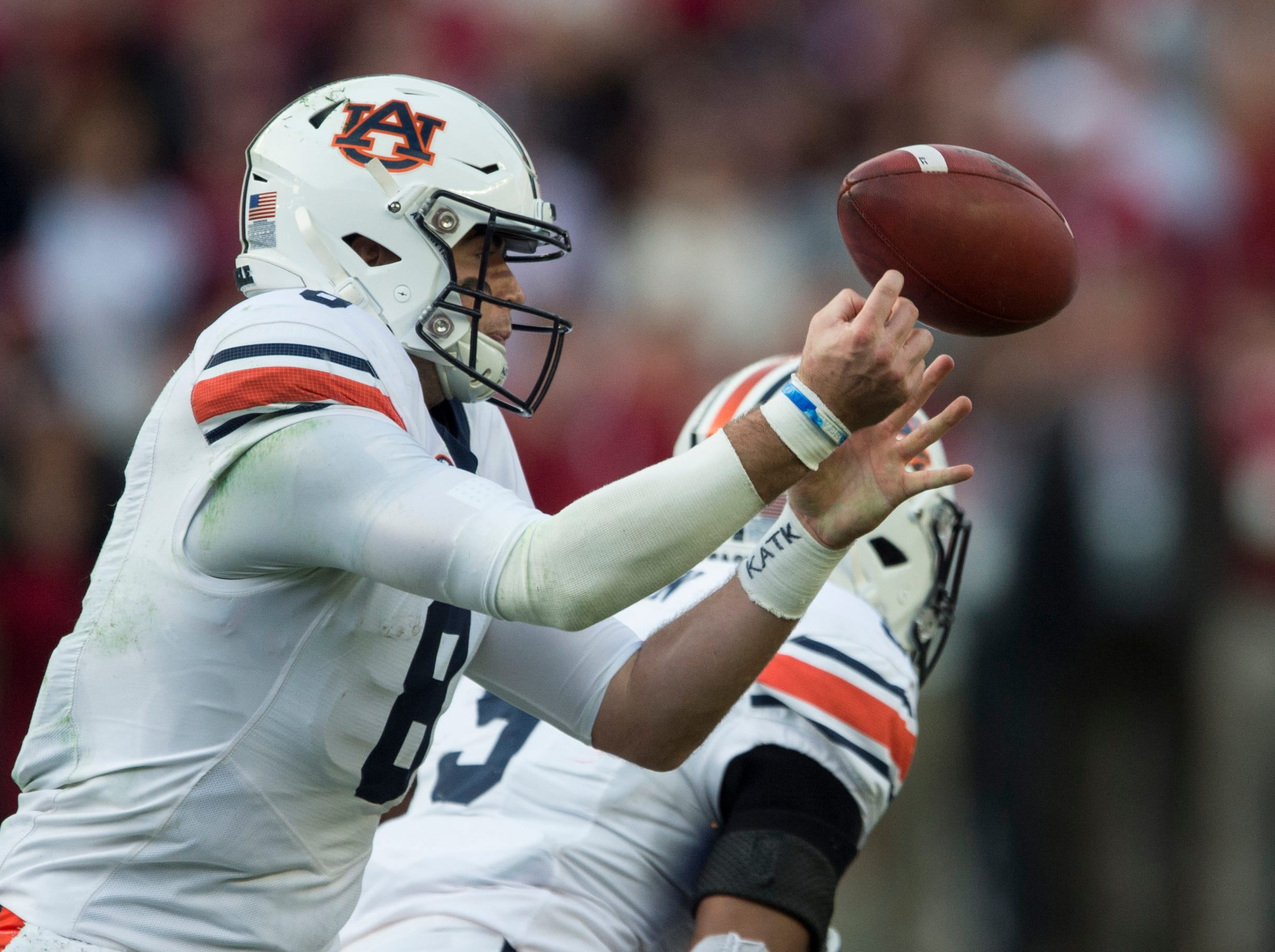 Auburn quarterback Jarrett Stidham (8) has the ball slip out of his hands as he throws the ball during the Iron Bowl at Bryant-Denny Stadium in Tuscaloosa, Ala., on Saturday, Nov. 24, 2018. Alabama leads Auburn 17-14 at halftime.