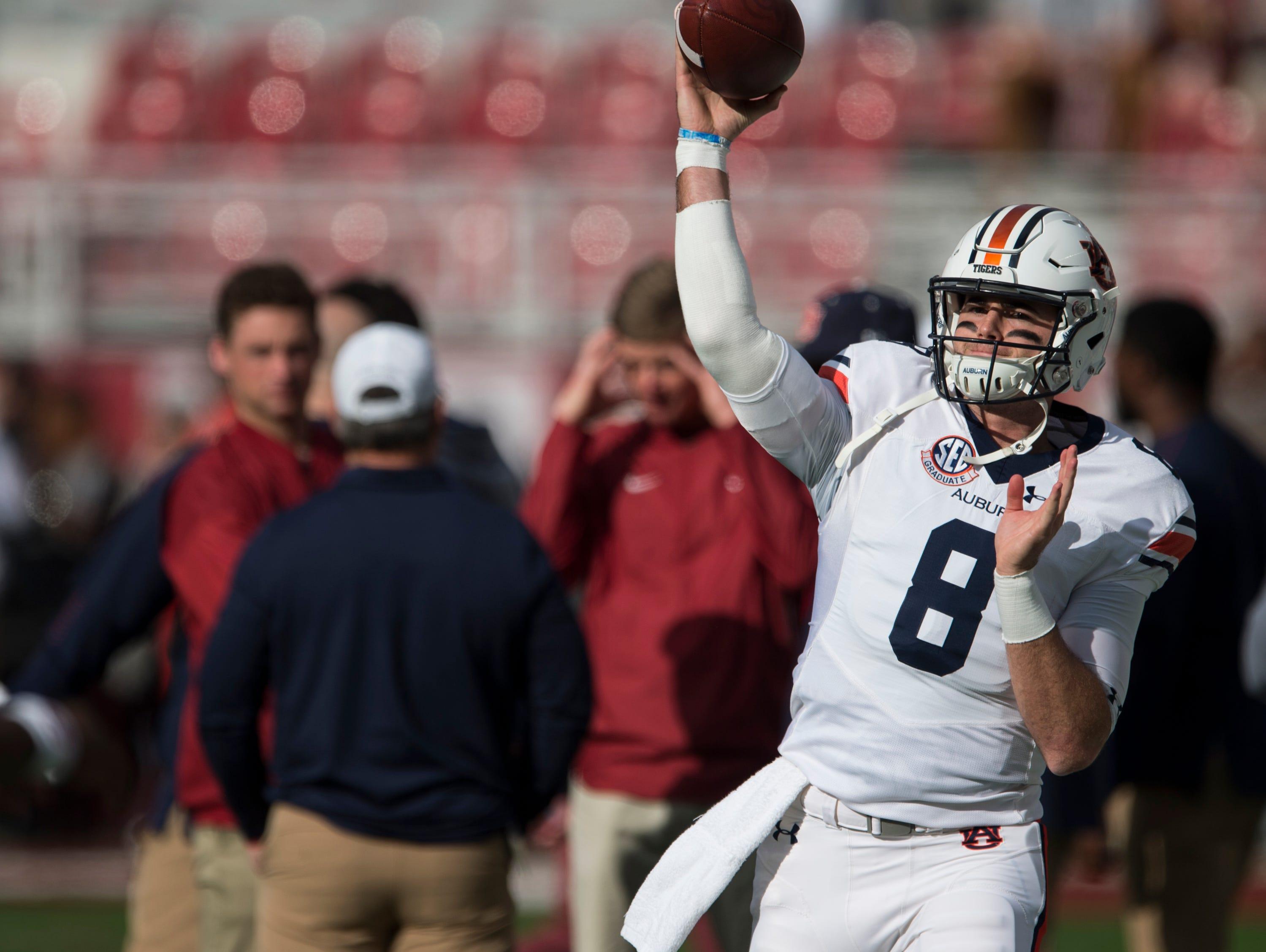 Auburn quarterback Jarrett Stidham (8) warms up before the Iron Bowl at Bryant-Denny Stadium in Tuscaloosa, Ala., on Saturday, Nov. 24, 2018.