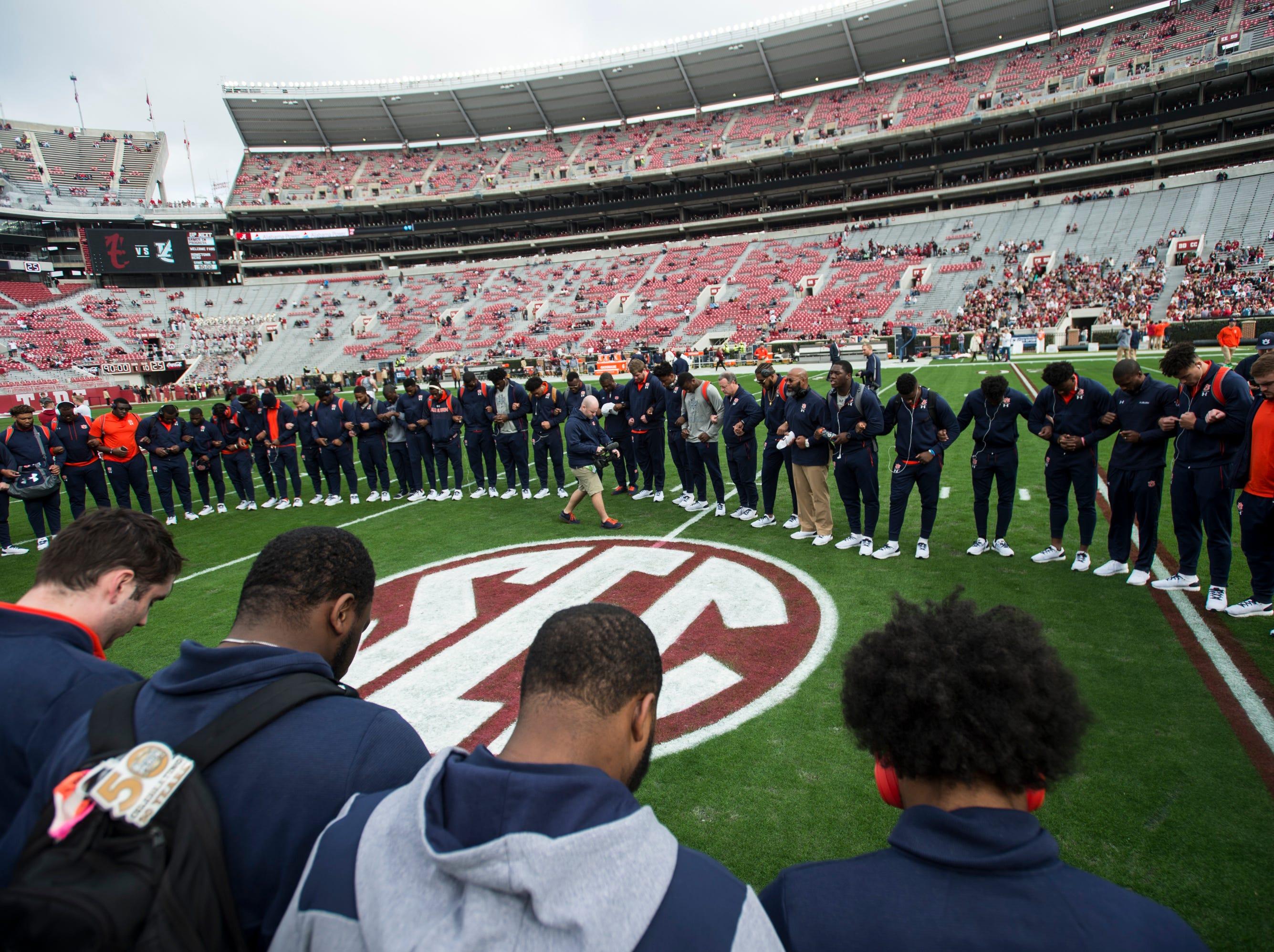 Auburn players huddle for a pregame prayer at Bryant-Denny Stadium in Tuscaloosa, Ala., on Saturday, Nov. 24, 2018.