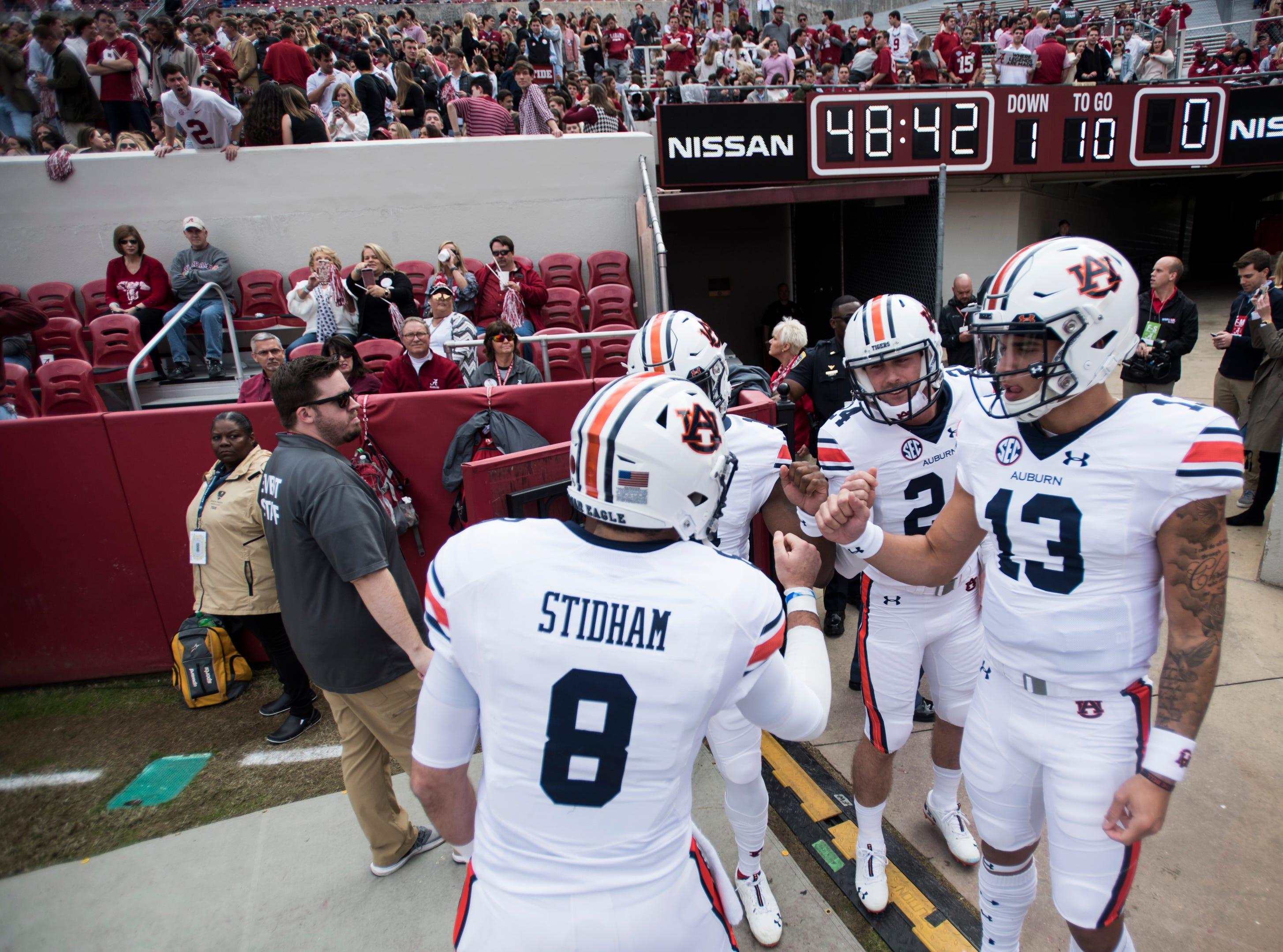 Auburn quarterback Jarrett Stidham (8) leads the quarterbacks onto the field for warm ups before the Iron Bowl at Bryant-Denny Stadium in Tuscaloosa, Ala., on Saturday, Nov. 24, 2018.
