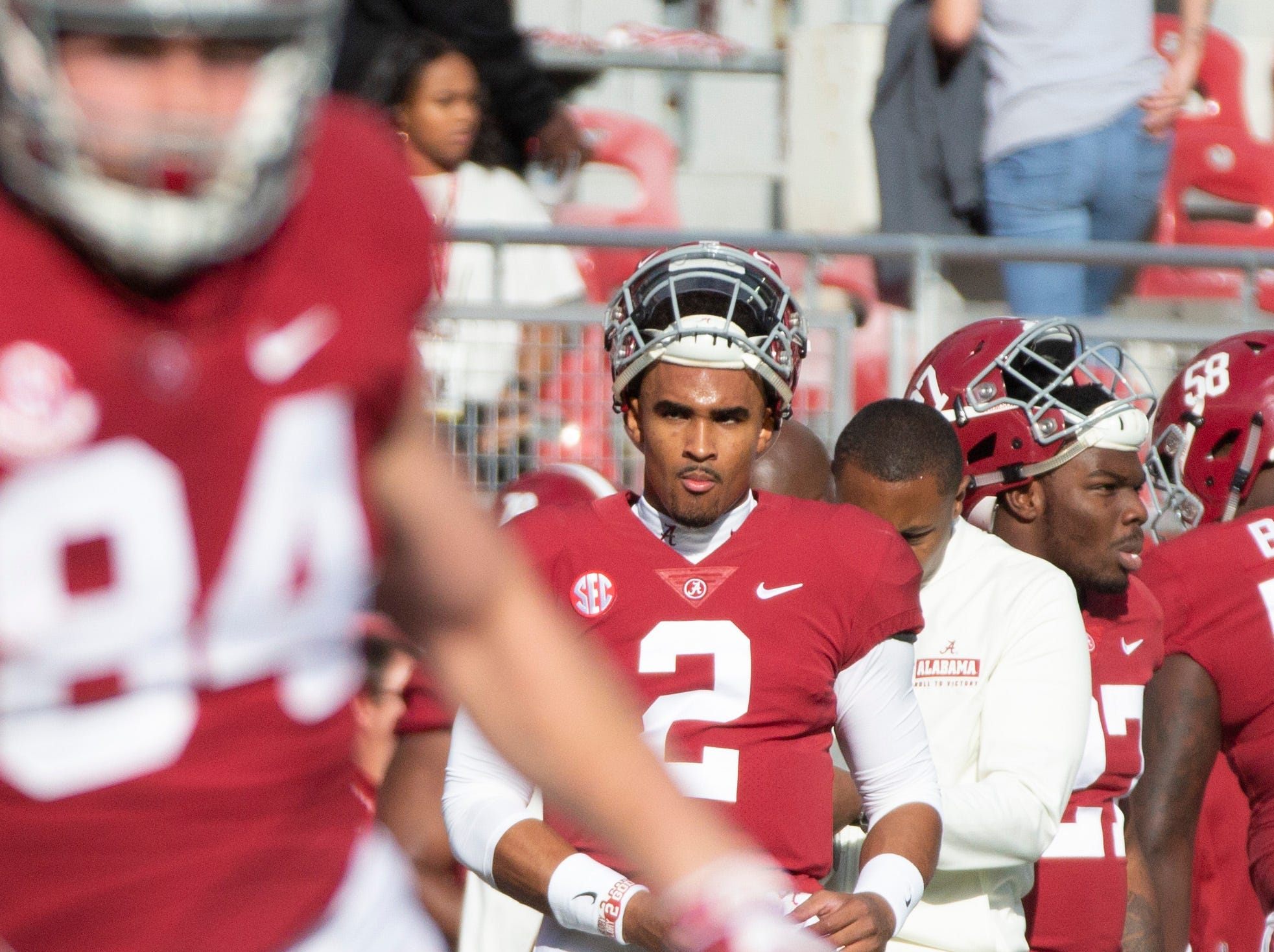 Alabama's Jalen Hurts looks on during practice drills.