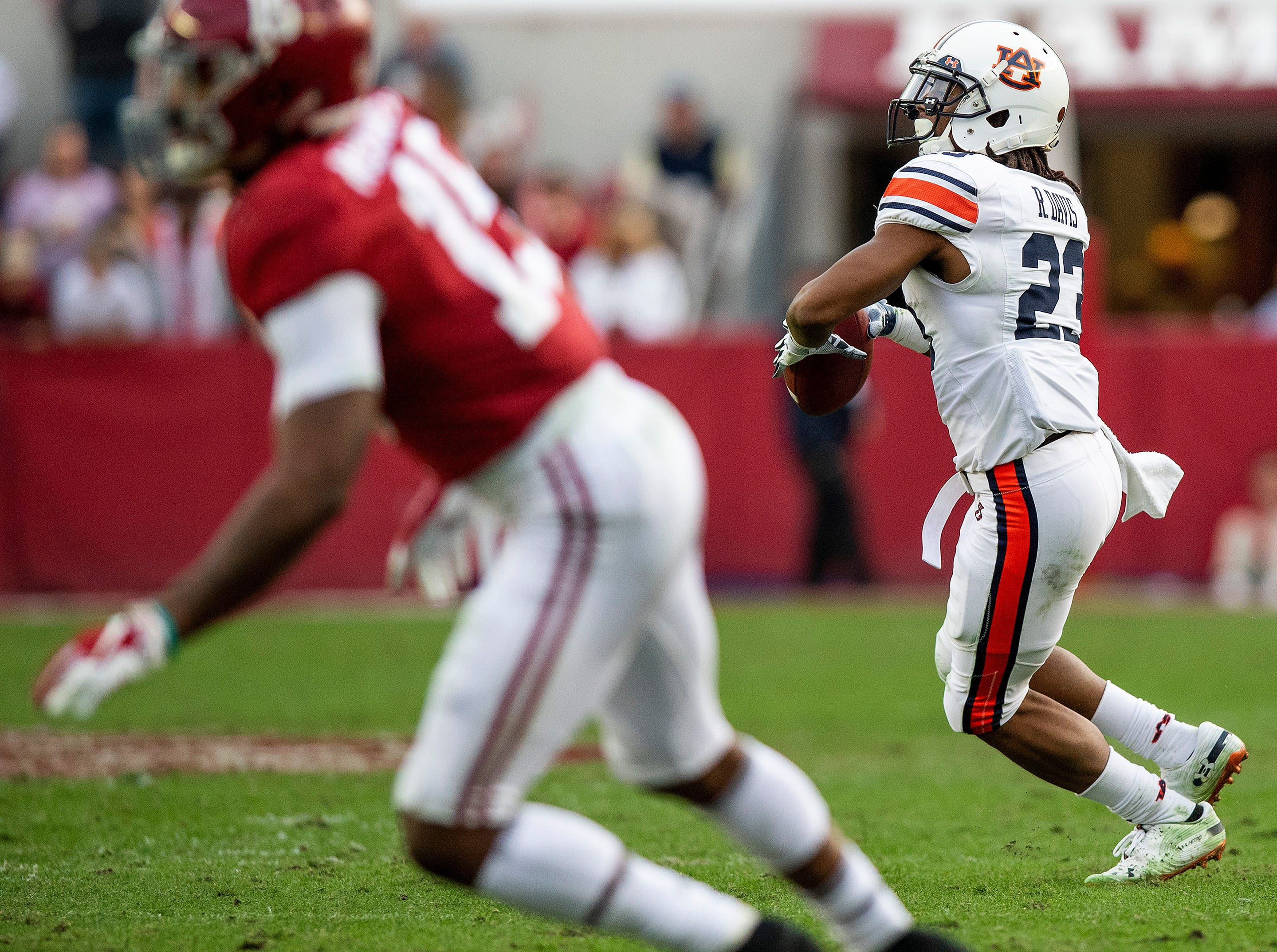 Auburn wide receiver Ryan Davis (23) throws a pass for a touchdown against Alabama in first half action during the Iron Bowl at Bryant-Denny Stadium in Tuscaloosa, Ala., on Saturday November 24, 2018.
