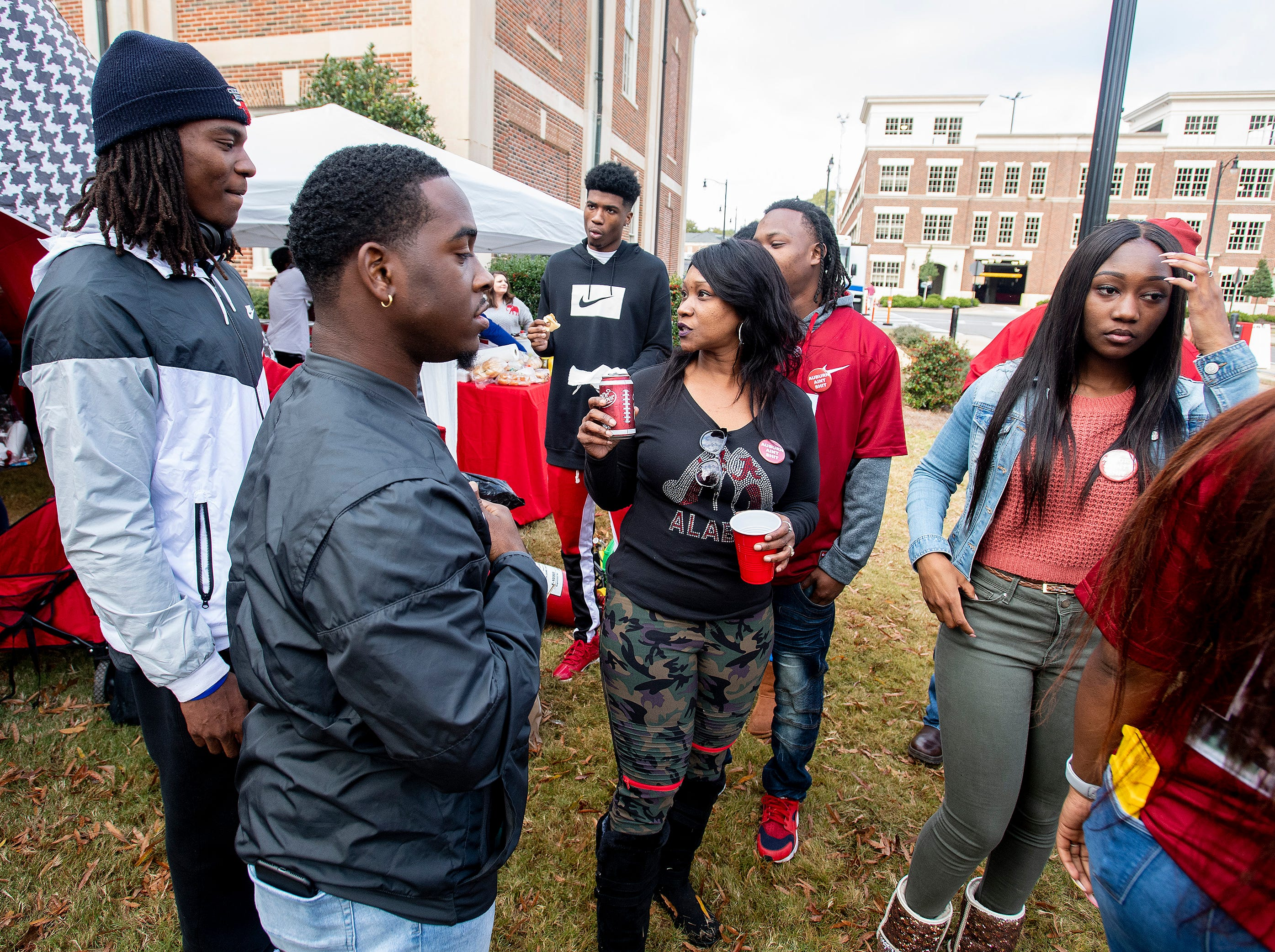 Nataki Ruggs, center, talks with her son Kevontae Ruggs, Ole Miss linebacker, as the Ruggs family and the family of Mack Wilson tailgate together before the Iron Bowl in Tuscaloosa, Ala., on Saturday November 24, 2018.