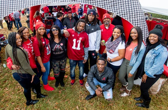 The family of Henry Ruggs tailgates with the Wilson family  before the Iron Bowl in Tuscaloosa, Ala., on Saturday November 24, 2018.