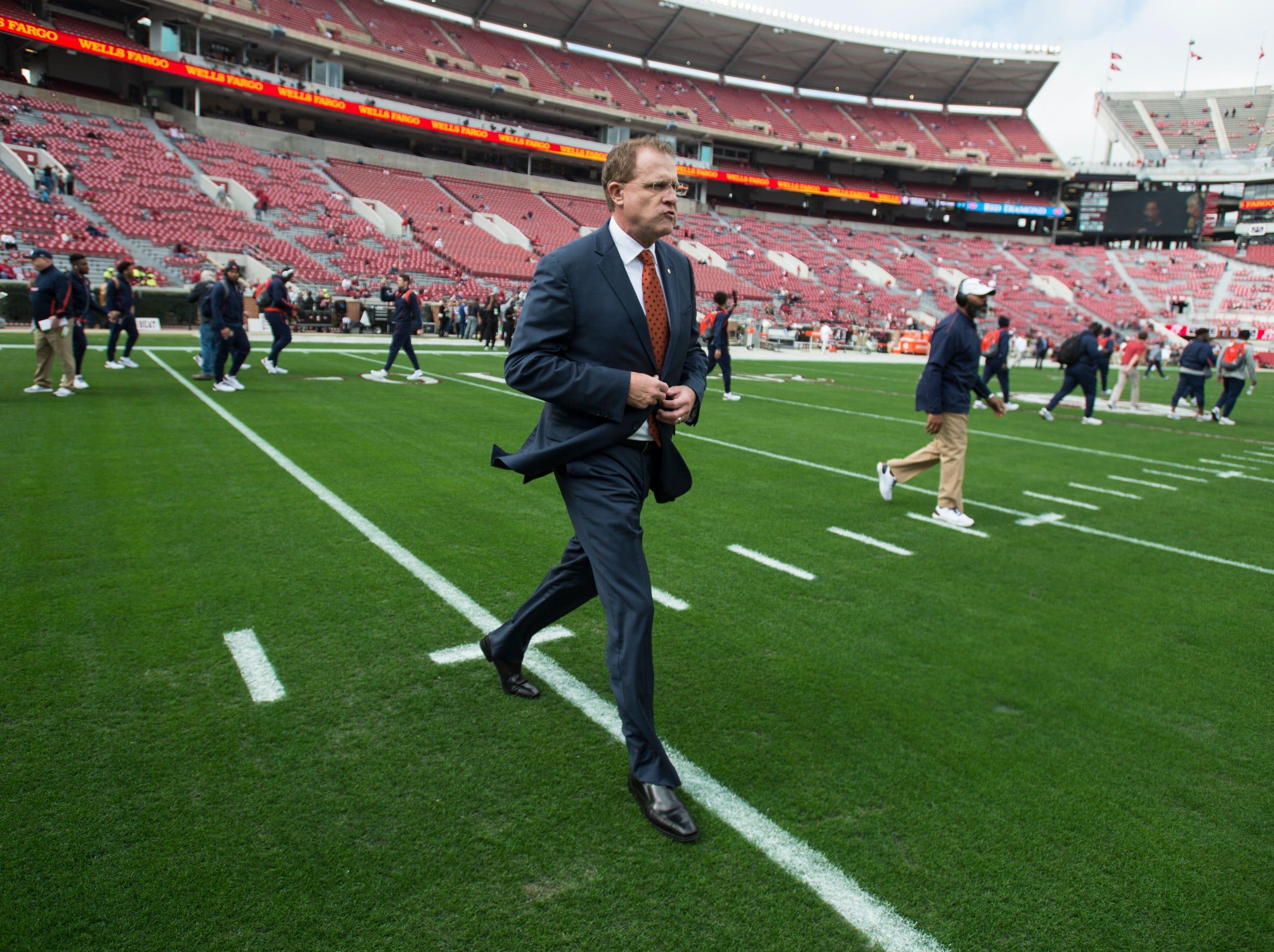 Auburn head coach Gus Malzahn walks the field as his team arrives at Bryant-Denny Stadium in Tuscaloosa, Ala., on Saturday, Nov. 24, 2018.
