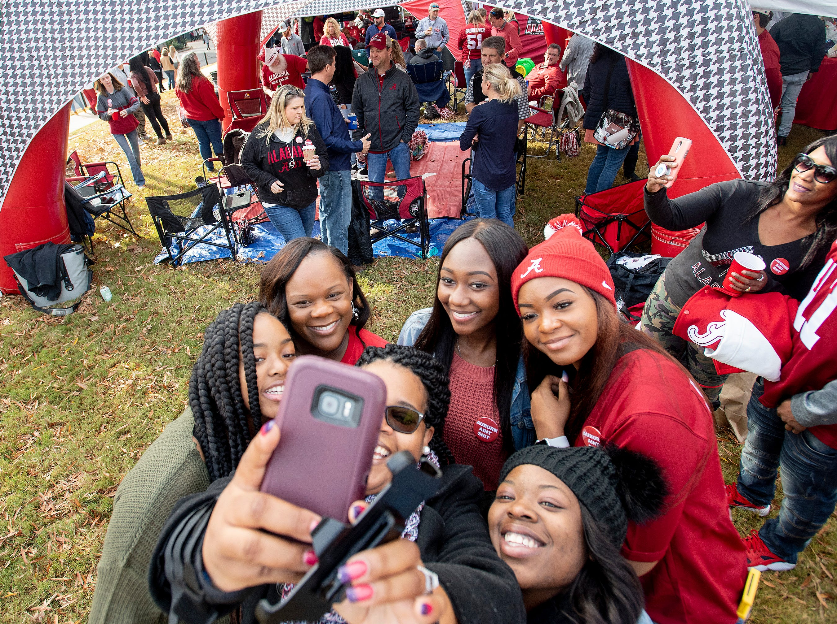 The Ruggs family does selfies as they tailgate with the Wilson family before the Iron Bowl in Tuscaloosa, Ala., on Saturday November 24, 2018.