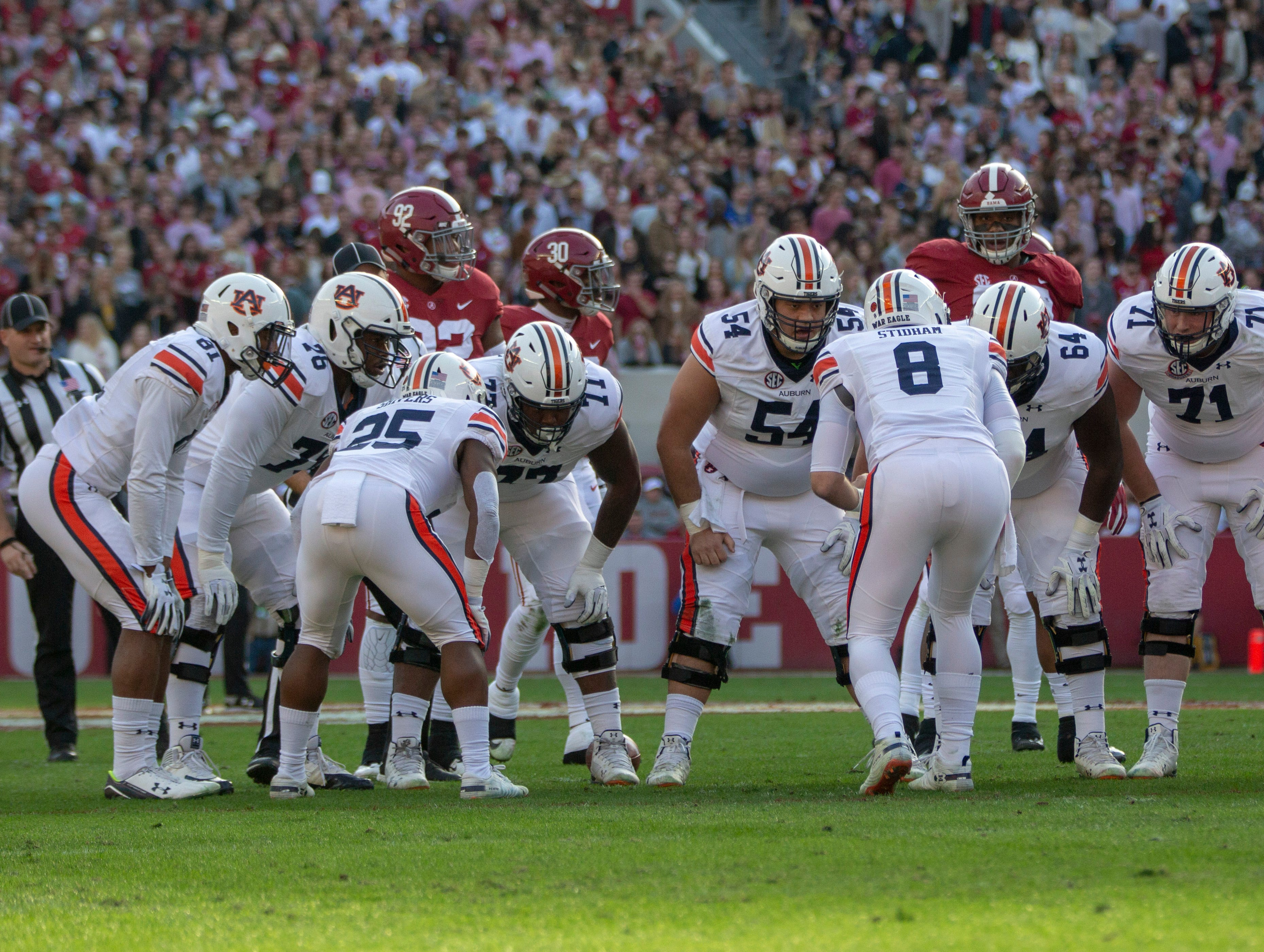 Auburn's team huddles around Jarrett Stidham before a play.