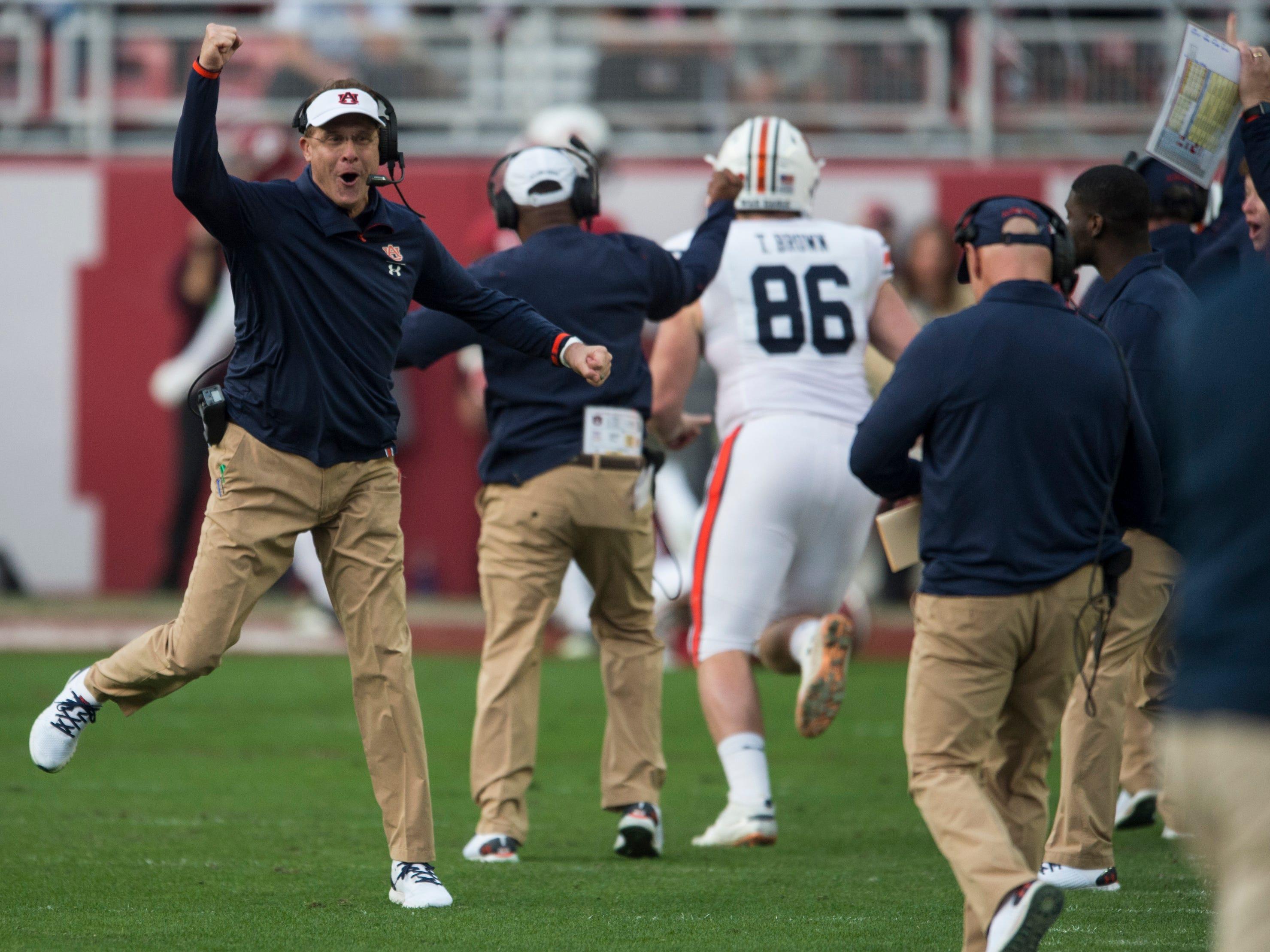 Auburn head coach Gus Malzahn celebrates a touchdown during the Iron Bowl at Bryant-Denny Stadium in Tuscaloosa, Ala., on Saturday, Nov. 24, 2018. Alabama leads Auburn 17-14 at halftime.