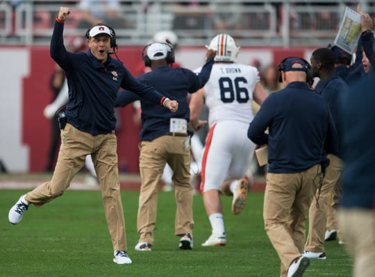 Auburn head coach Gus Malzahn celebrates a touchdown during the Iron Bowl at Bryant-Denny Stadium in Tuscaloosa, Ala., on Saturday, Nov. 24, 2018. Alabama leads Auburn 17-14 at halftime.