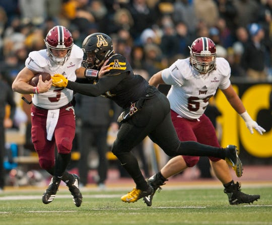 Appalachian State Okon Godwin (47) gets past Troy lineman J.L Gaston to pressure quarterback Sawyer Smith in the second quarter during an NCAA football game, Saturday, Nov. 24, 2018 at Kidd Brewer Stadium in Boone, N.C. (Walt Unks/The Winston-Salem Journal via AP)