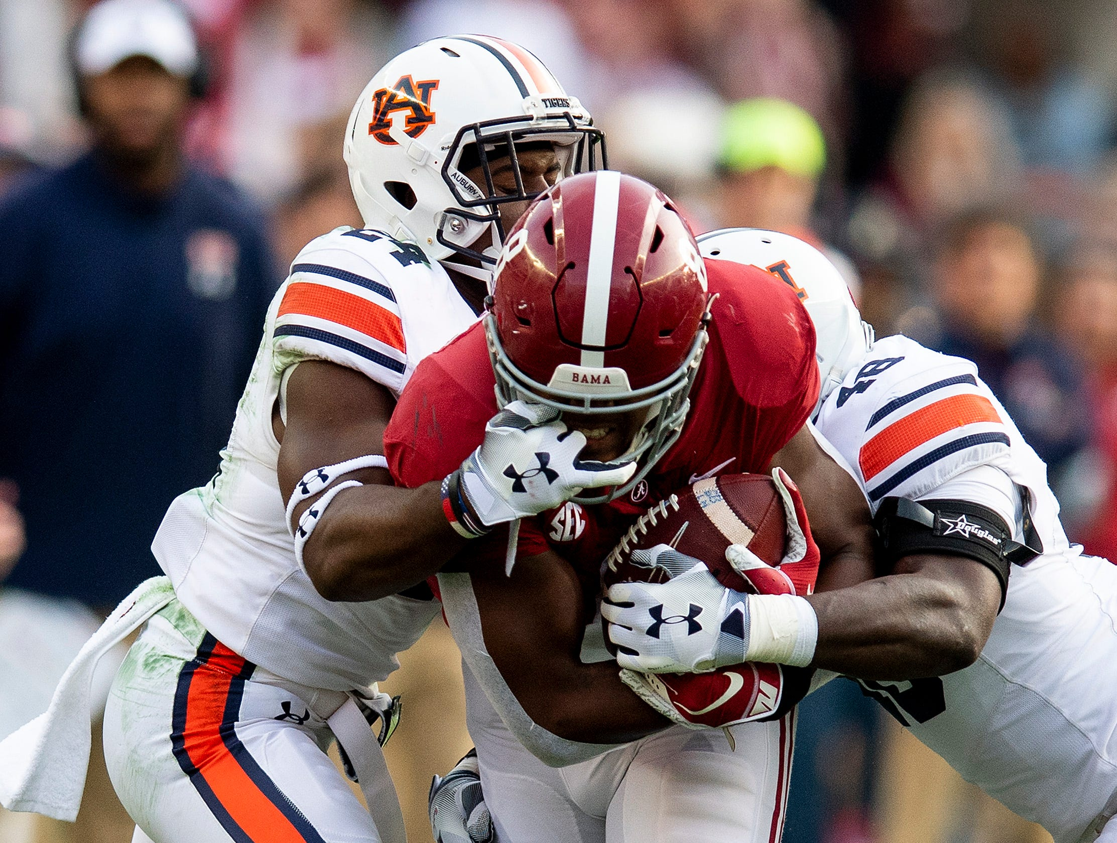 Auburn defensive back Daniel Thomas (24) gets in the facemark of Alabama running back Josh Jacobs (8) in first half action during the Iron Bowl at Bryant-Denny Stadium in Tuscaloosa, Ala., on Saturday November 24, 2018.