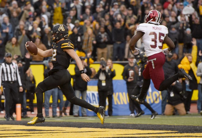 Appalachian State quarterback Zac Thomas gets past Troy's Tyler Murray to score a touchdown in the second quarter during an NCAA college football game, Saturday, Nov. 24, 2018 at Kidd Brewer Stadium in Boone, N.C. (Walt Unks/The Winston-Salem Journal via AP)