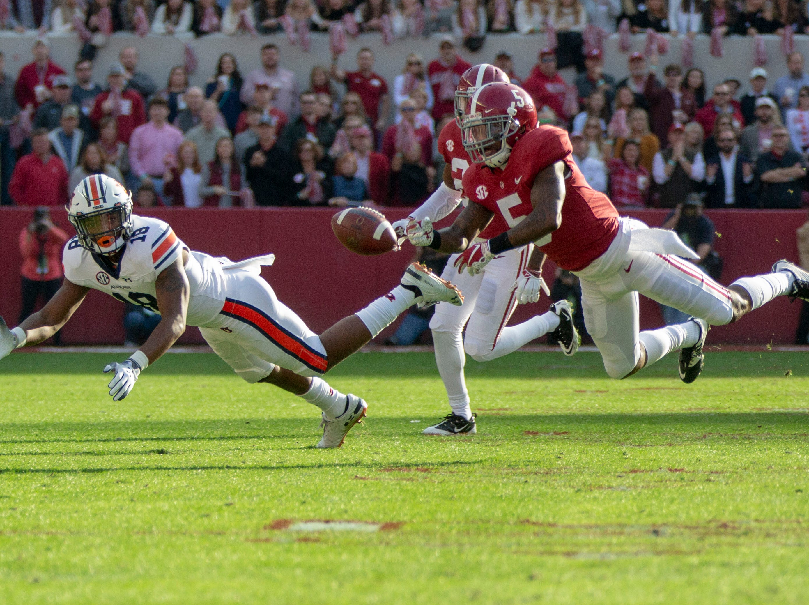 Alabama's Shyheim Carter dives for a pass intended for Auburn's Seth Williams.