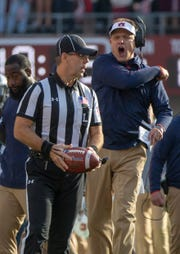 Auburn head coach Gus Malzahn gets irate with an official during the first quarter of the Iron Bowl.