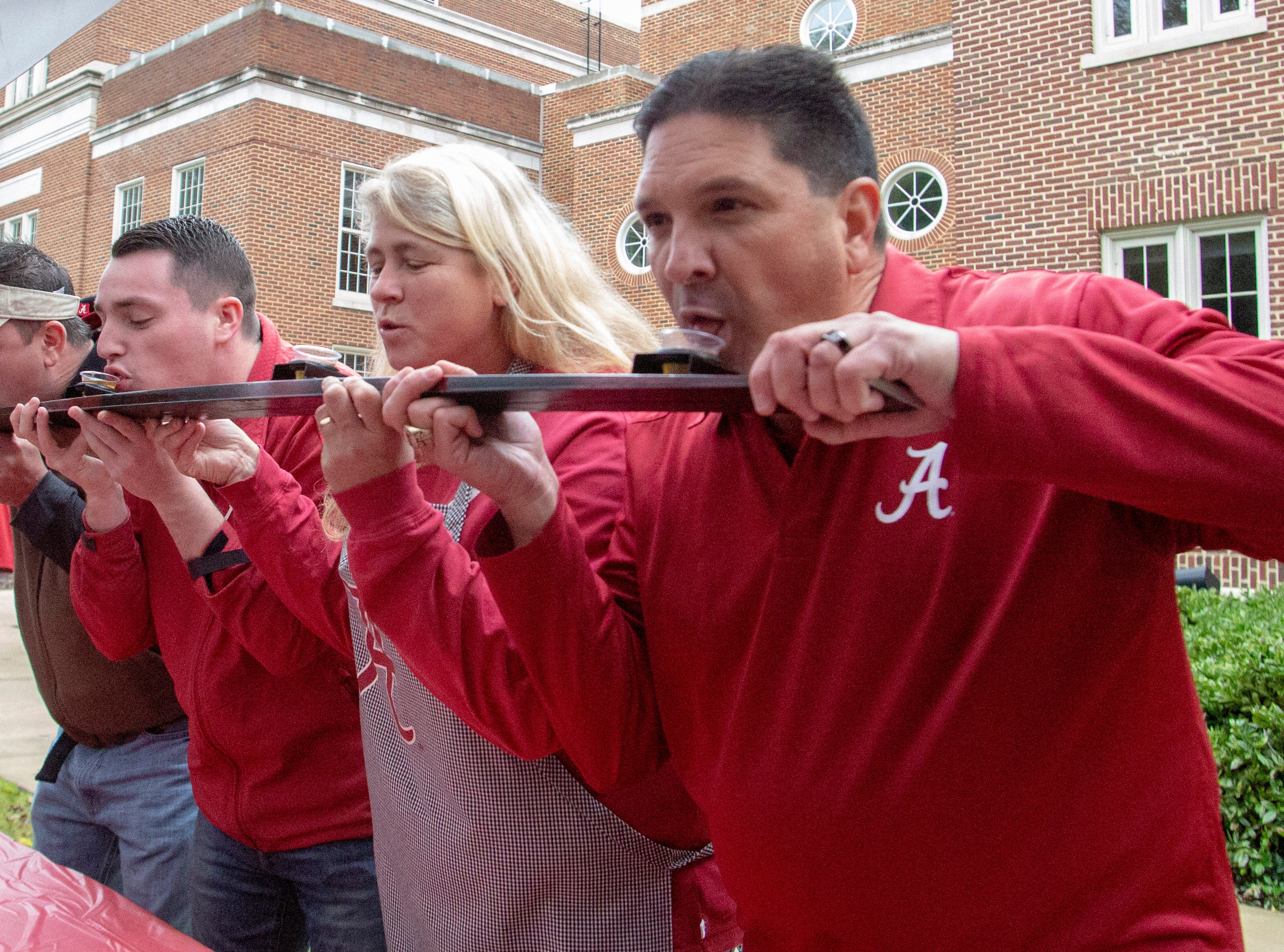 Alabama fans John Higginbotham, Jason Kaylan, Scotty Baker and Brian Ray take shots from a ski.