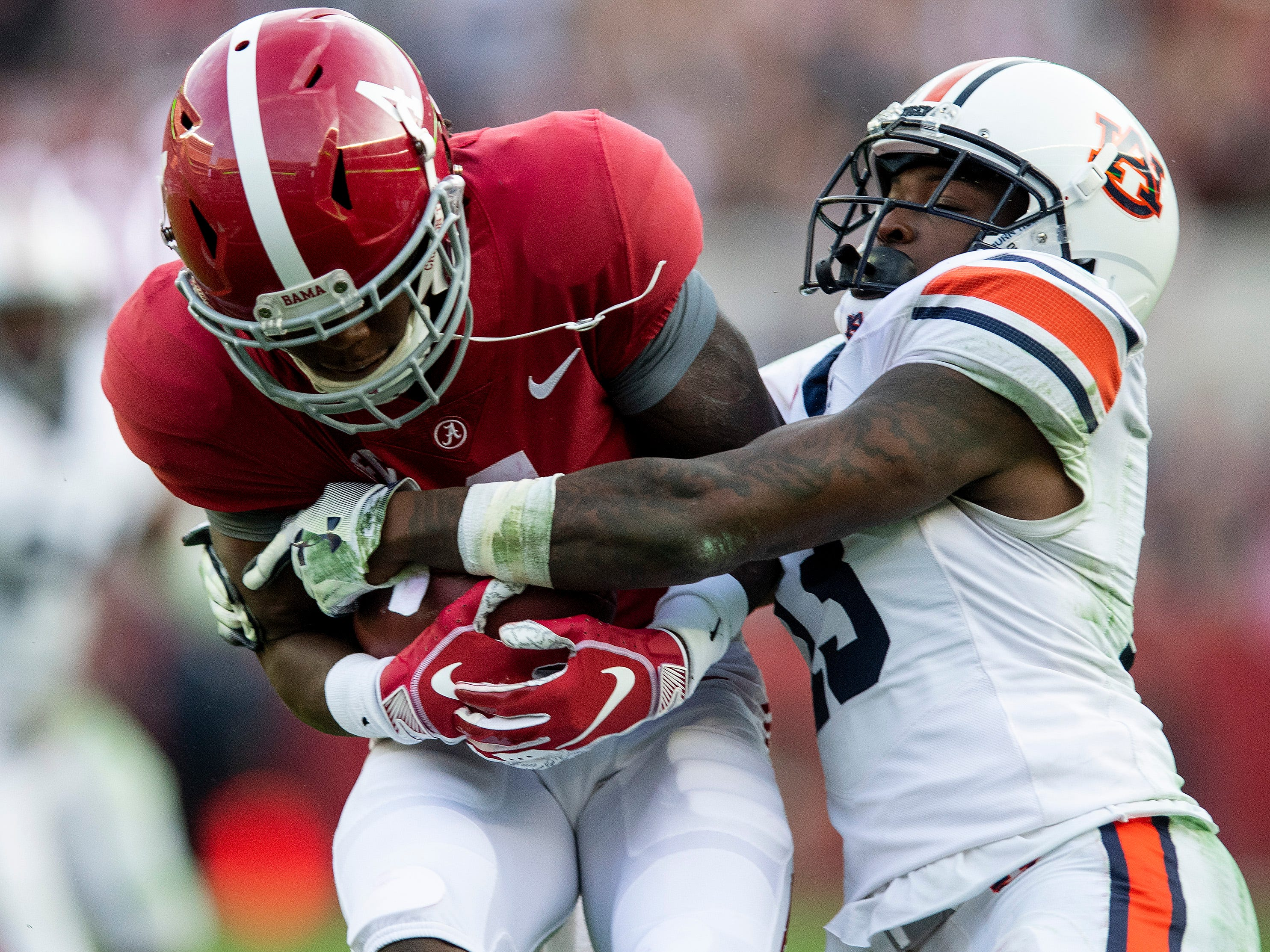 Auburn defensive back Javaris Davis (13) stops Alabama wide receiver Jerry Jeudy (4) in first half action during the Iron Bowl at Bryant-Denny Stadium in Tuscaloosa, Ala., on Saturday November 24, 2018.