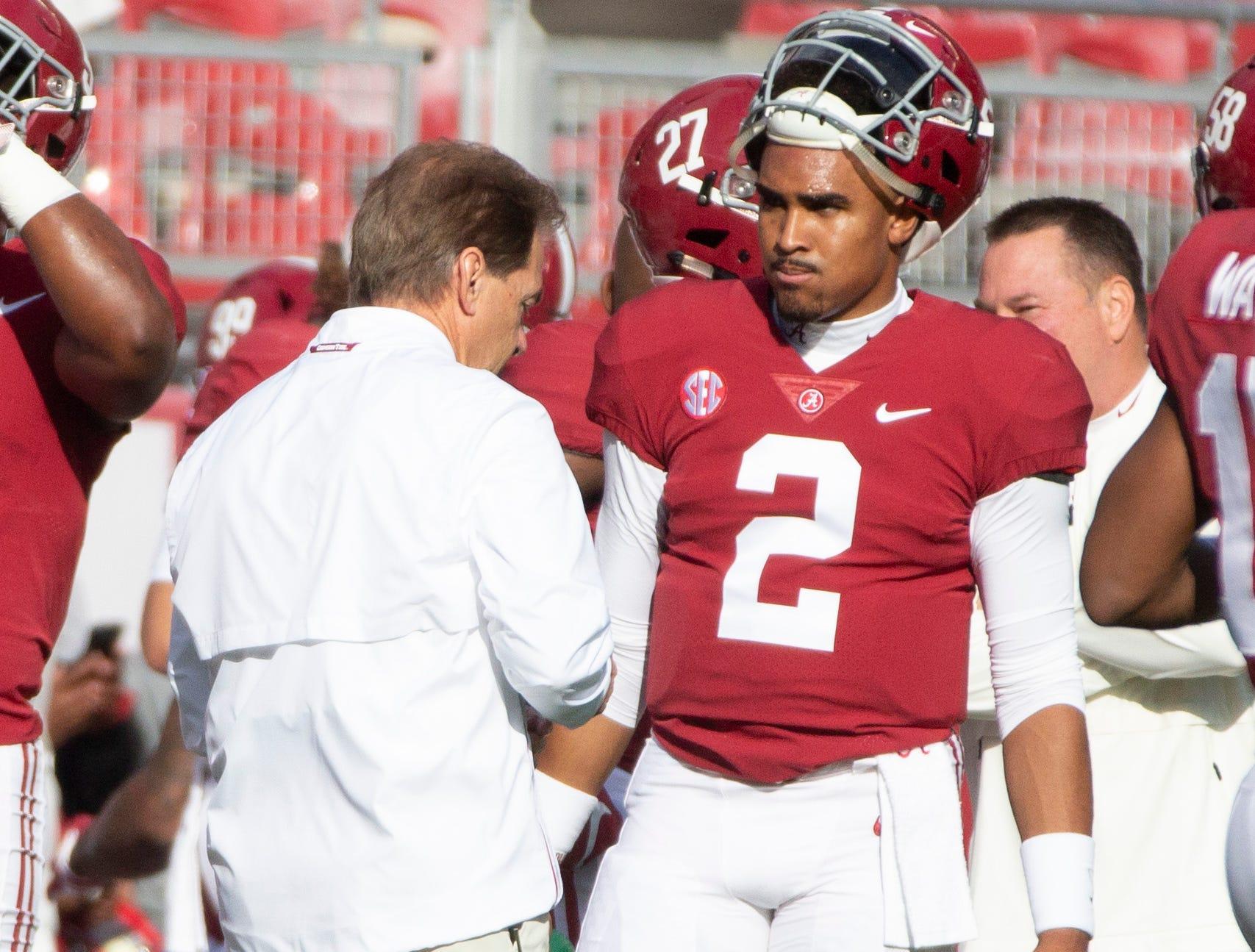 Alabama head coach Nick Saban talks with Jalen Hurts during a few practice drills.