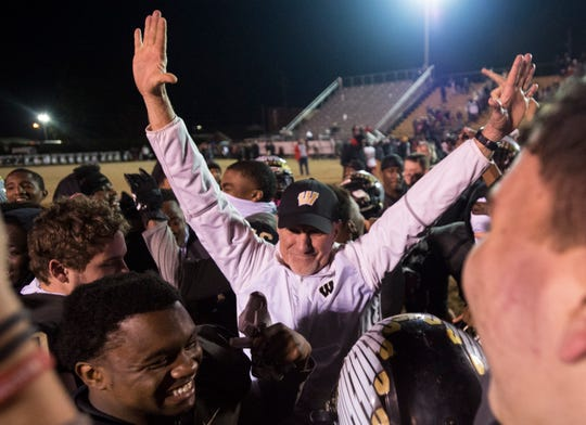 "Wetumpka head coach Tim Perry dances to ""Mo Bamba"" by Sheck Wes as he celebrates with his team after the class 6A quarterfinal state playoff game at Hohenberg Field in Wetumpka, Ala., on Friday, Nov. 23, 2018. Wetumpka defeats Spanish Fort 21-17."
