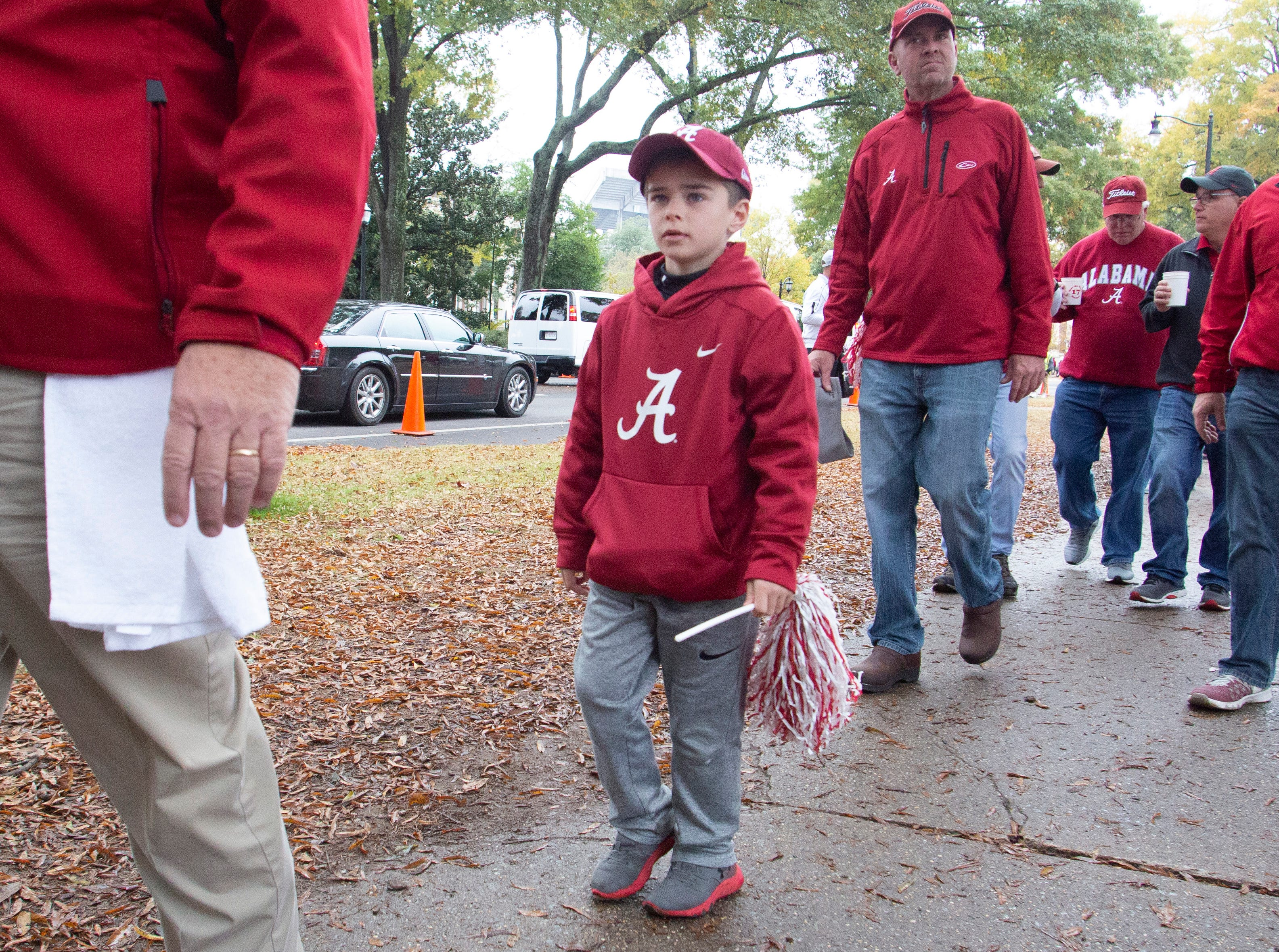 Alabama and Auburn fans mingle for Iron Bowl tailgating.