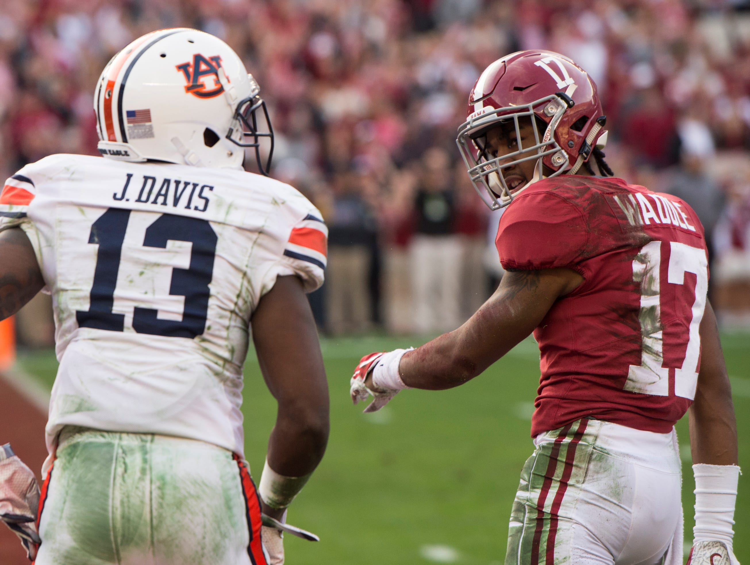 Alabama wide receiver Jaylen Waddle (17) looks back at Auburn defensive back Javaris Davis (13) after Davis was called for a pass interference on Waddle during the Iron Bowl at Bryant-Denny Stadium in Tuscaloosa, Ala., on Saturday, Nov. 24, 2018. Alabama leads Auburn 17-14 at halftime.