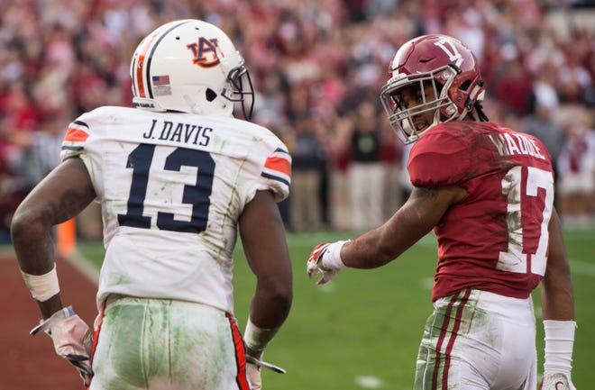 Alabama wide receiver Jaylen Waddle (17) looks back at Auburn defensive back Javaris Davis (13) during the Iron Bowl at Bryant-Denny Stadium in Tuscaloosa, Ala., on Saturday, Nov. 24, 2018.
