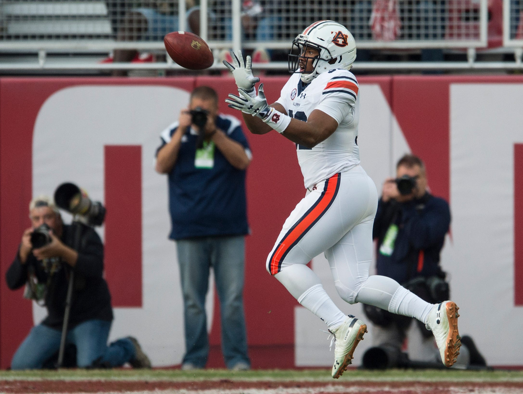 Auburn running back Malik Miller (32) catches a pass for a touchdown during the Iron Bowl at Bryant-Denny Stadium in Tuscaloosa, Ala., on Saturday, Nov. 24, 2018. Alabama leads Auburn 17-14 at halftime.