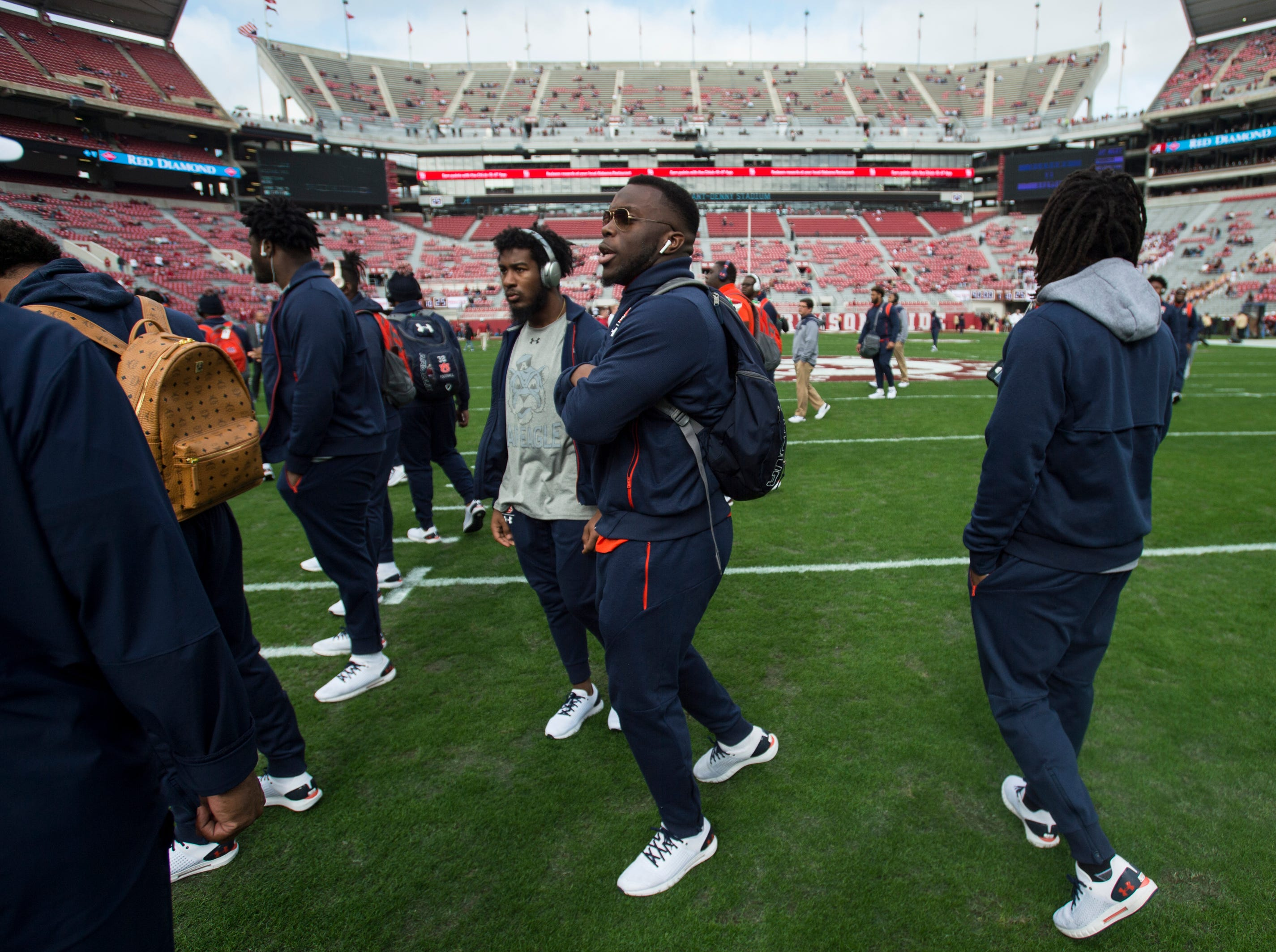 Auburn players get pumped up as they huddle on the field at Bryant-Denny Stadium in Tuscaloosa, Ala., on Saturday, Nov. 24, 2018.
