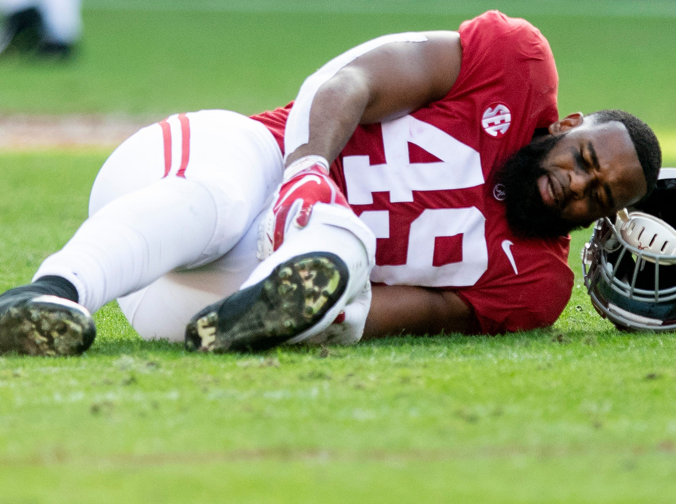 Alabama defensive lineman Isaiah Buggs (49) is injured against Auburn in first half action during the Iron Bowl at Bryant-Denny Stadium in Tuscaloosa, Ala., on Saturday November 24, 2018.