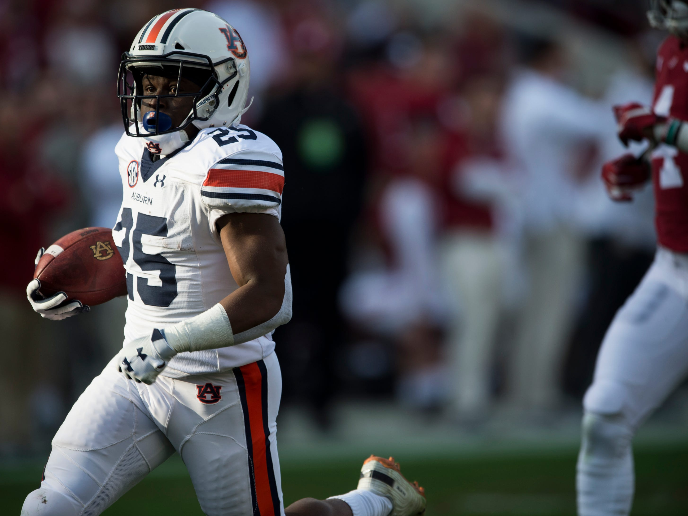 Auburn running back Shaun Shivers (25) breaks a big run that is called back after a holding penalty during the Iron Bowl at Bryant-Denny Stadium in Tuscaloosa, Ala., on Saturday, Nov. 24, 2018. Alabama leads Auburn 17-14 at halftime.
