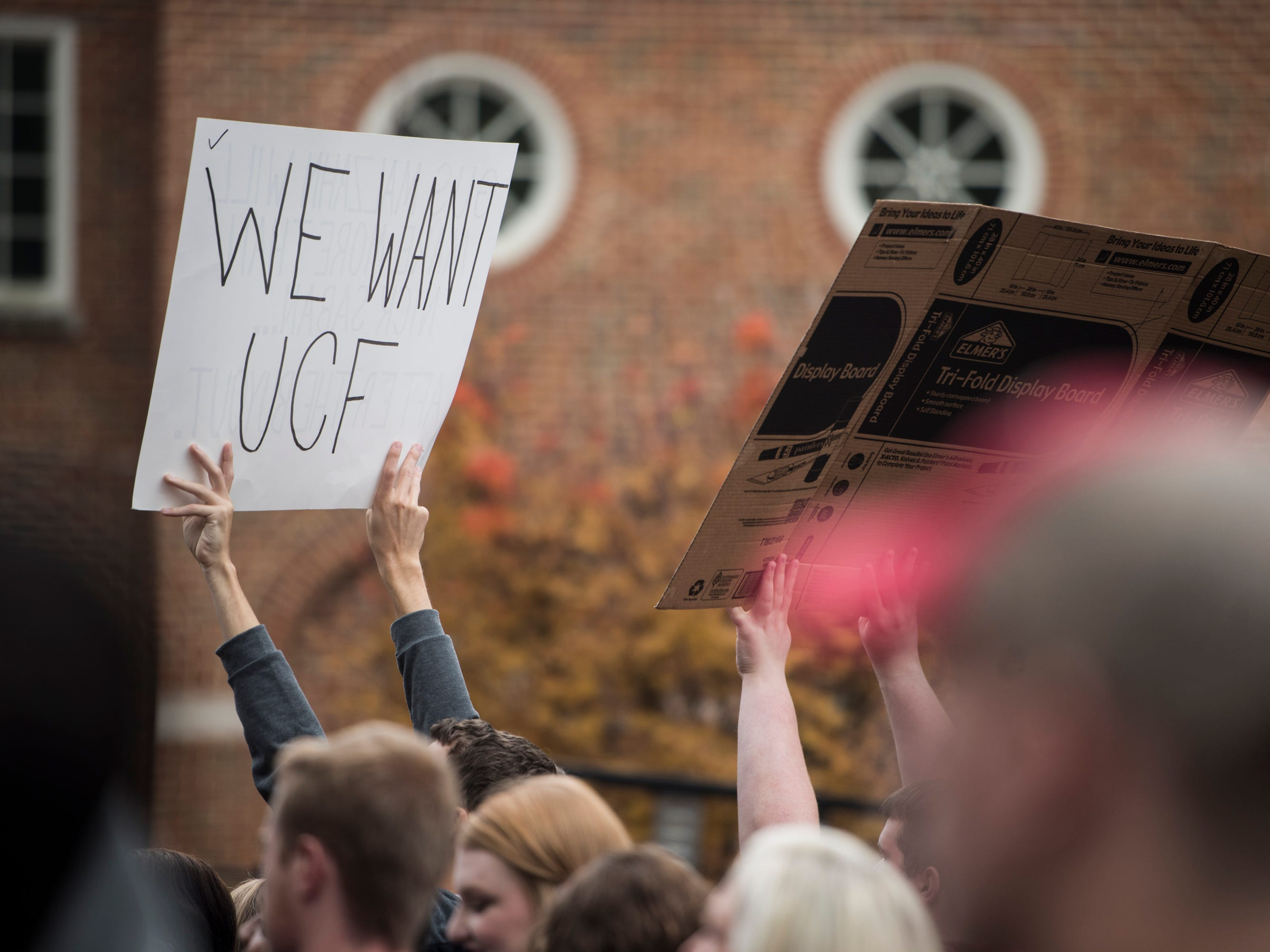 Fans hold up signs at the SEC Nation broadcast set outside Bryant-Denny Stadium in Tuscaloosa, Ala., on Saturday, Nov. 24, 2018.