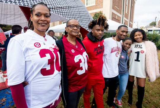 Mack Wilson's family, including mother Sandra Wilson, left, tailgate with the Ruggs family before the Iron Bowl in Tuscaloosa, Ala., on Saturday November 24, 2018.
