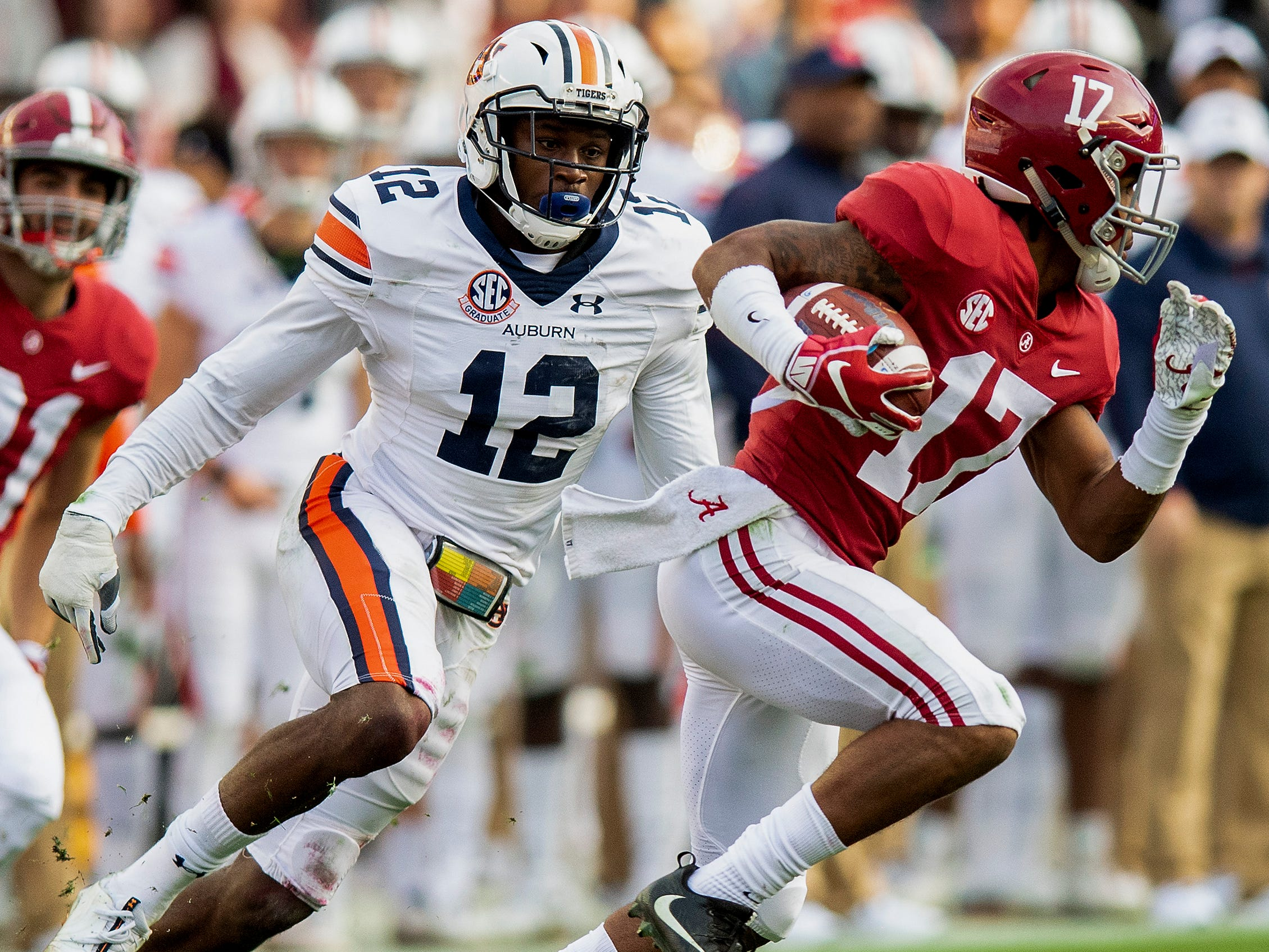 Auburn defensive back Jamel Dean (12) chases down Alabama wide receiver Jaylen Waddle (17) during the Iron Bowl at Bryant-Denny Stadium in Tuscaloosa, Ala., on Saturday November 24, 2018.