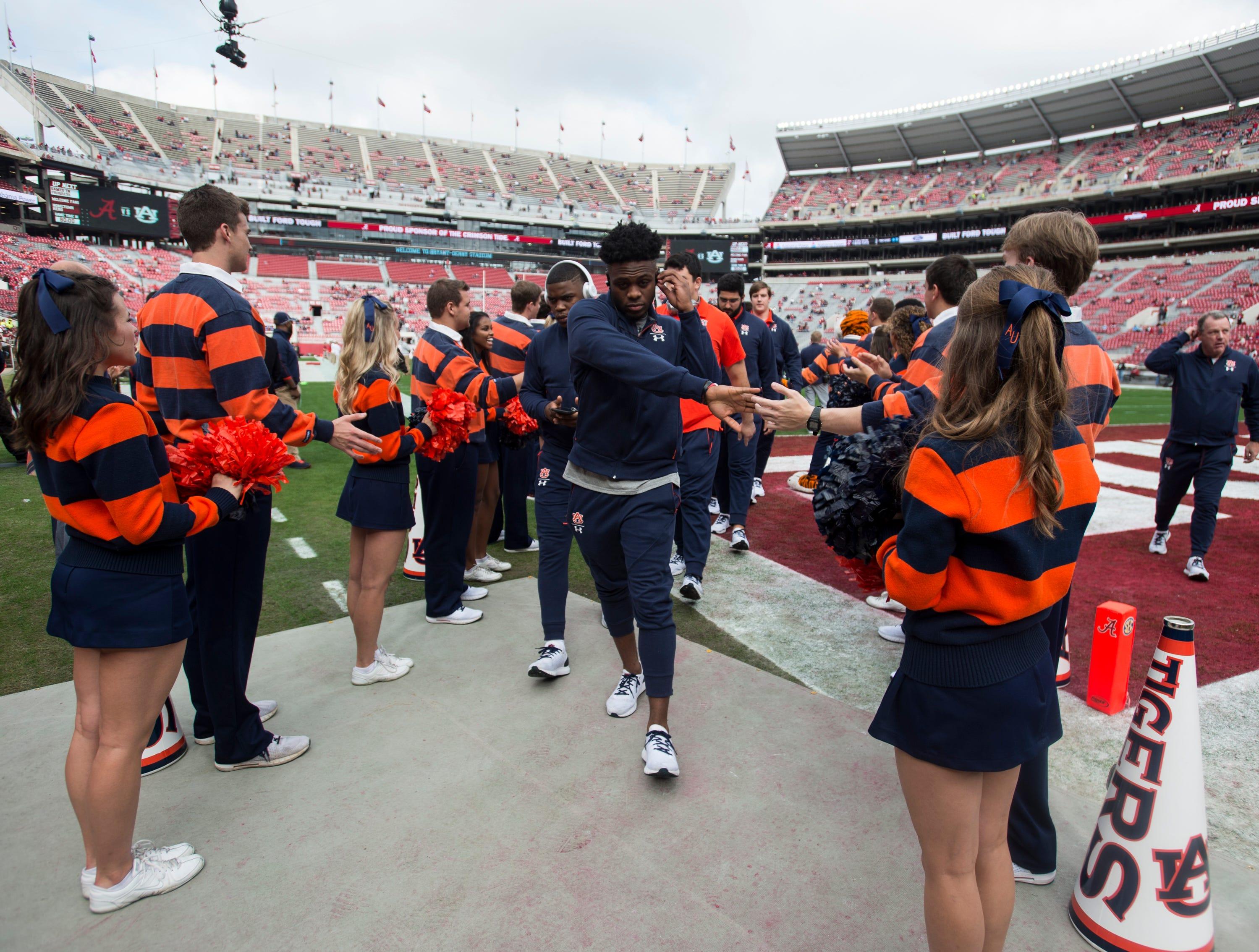 Auburn players head to the locker room at Bryant-Denny Stadium in Tuscaloosa, Ala., on Saturday, Nov. 24, 2018.