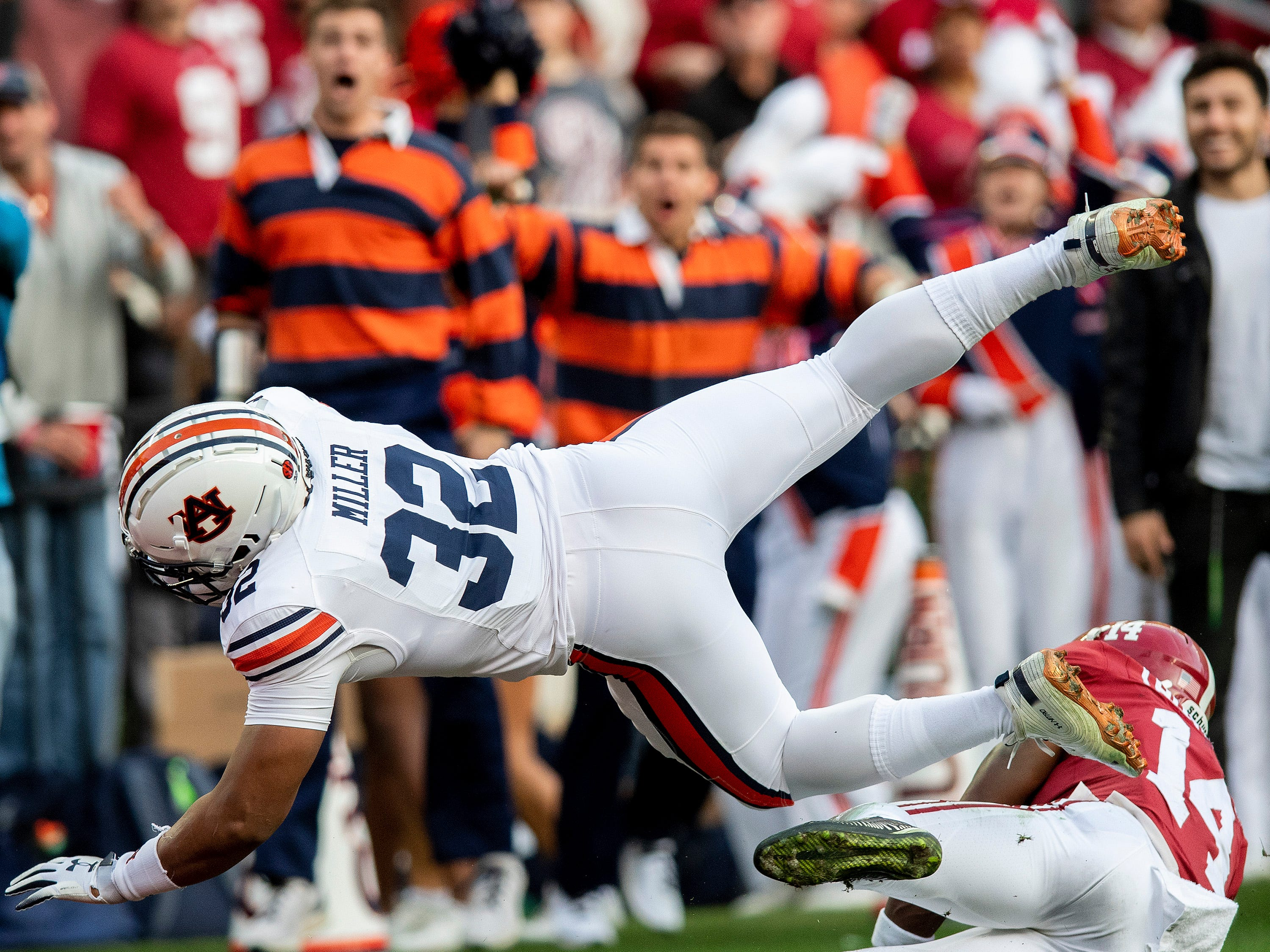 Auburn running back Malik Miller (32) dives ion for a touchdown against Alabama defensive back Deionte Thompson (14) in first half action during the Iron Bowl at Bryant-Denny Stadium in Tuscaloosa, Ala., on Saturday November 24, 2018.