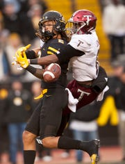 Troy cornerback Marcus Jones is called for pass interference in the end zone as he climbs over the back of Appalachian State wide receiver Corey Sutton in the second quarter during an NCAA college football game, Saturday, Nov. 24, 2018 at Kidd Brewer Stadium in Boone, N.C. (Walt Unks/The Winston-Salem Journal via AP)